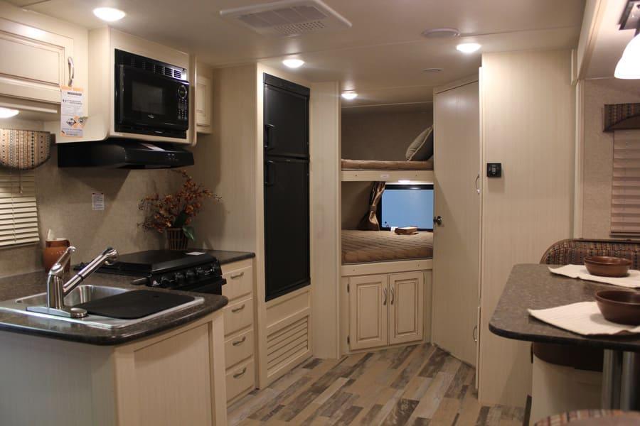 Bunk beds, refrigerator, microwave, sink, and oven.. Winnebago Minnie 2017