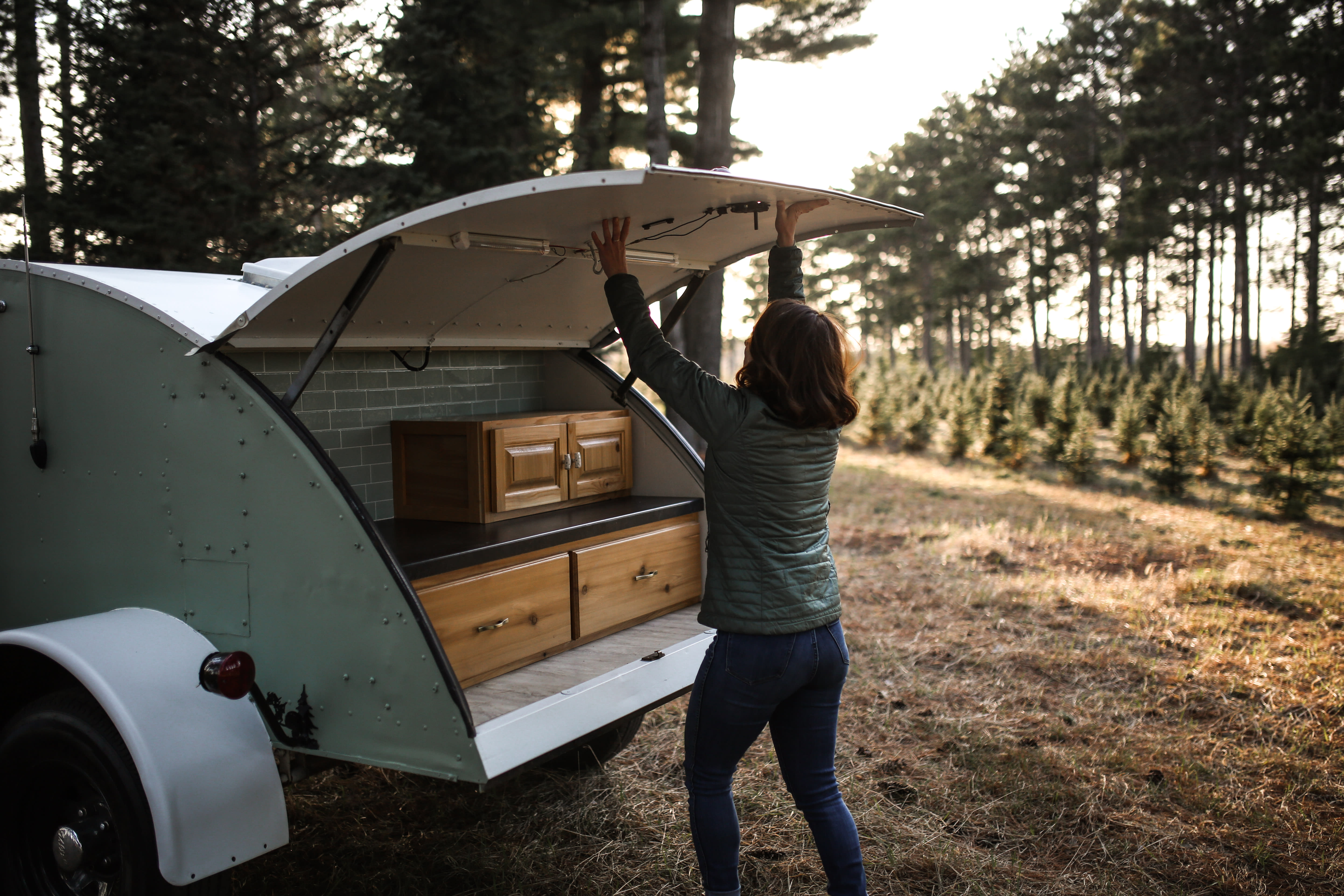 Kitchen comes equipped with butane stove, pots and pans, utensils, cutting board, plates, bowls, coffee making supplies and more. Custom Teardrop Camper 1945