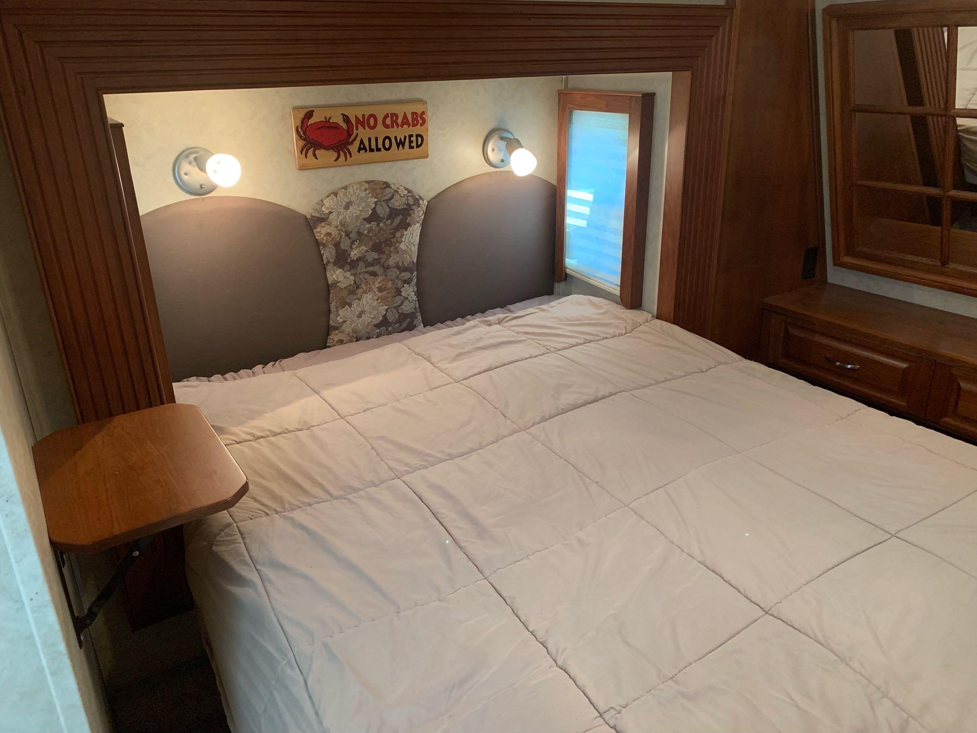 Queen bed in master. Dutchmen VictoryLane 2006
