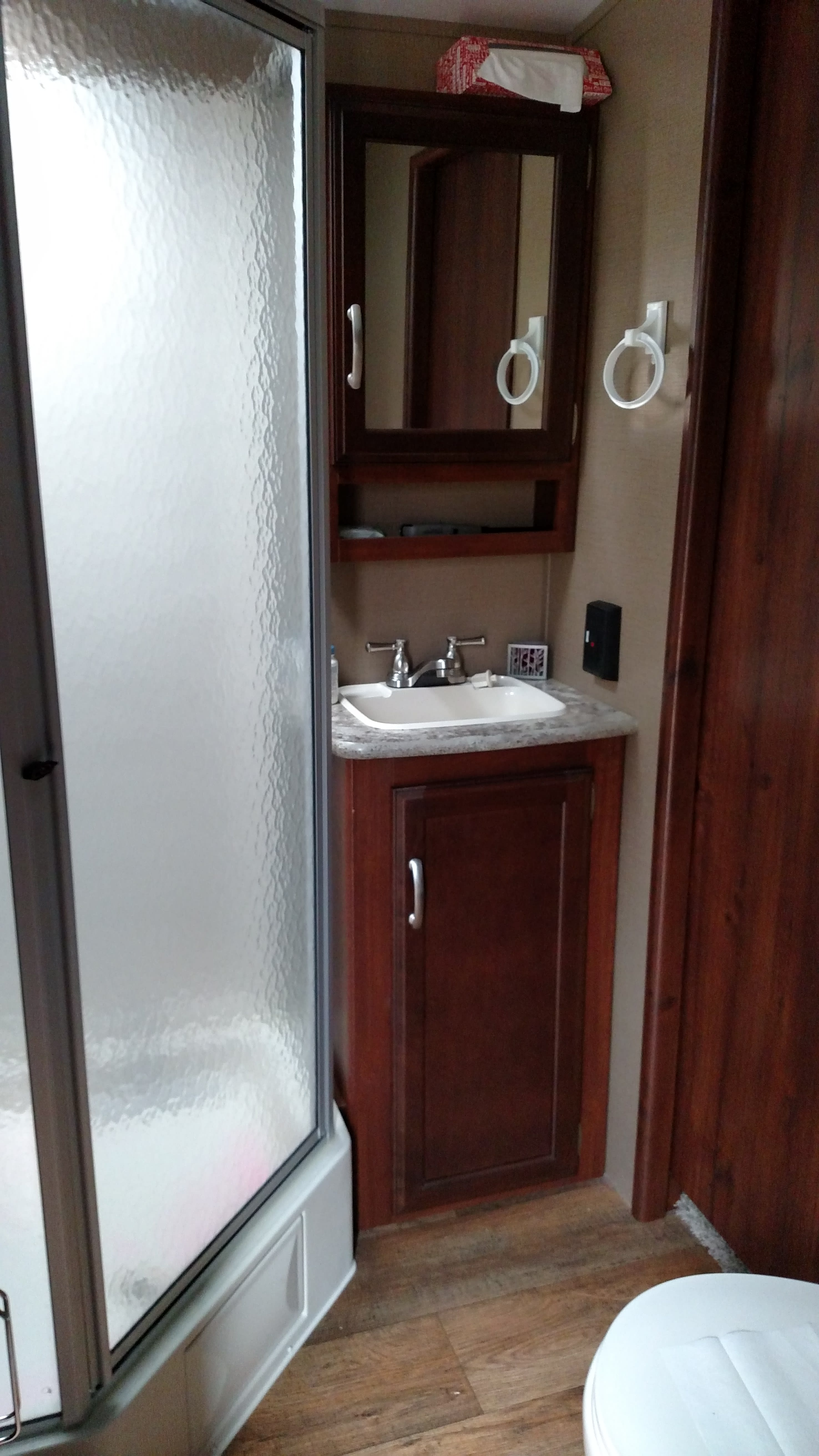 Spacious bathroom with shower and extra closet space!. Keystone Outback 2016