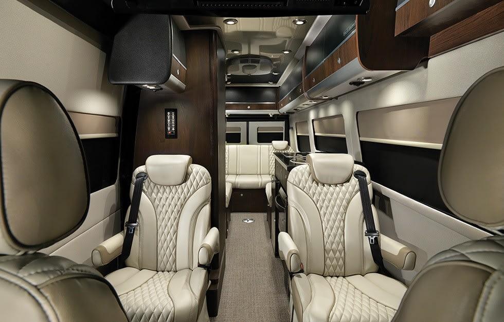High end gulfstream jet seats line this 9 passenger van.. Airstream Interstate Lounge Slate Edition 2019