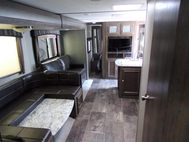 Shown with table down to make an extra bed.. Keystone Passport 2019