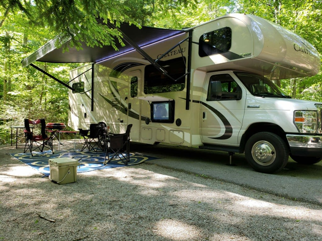 Oversized Electric Awning that can be controlled with a Remote Control.  Remote also controls the outside LED light strip under the awning, the Slide Out and the Generator!. Thor Motor Coach Chateau Bunk House 2018