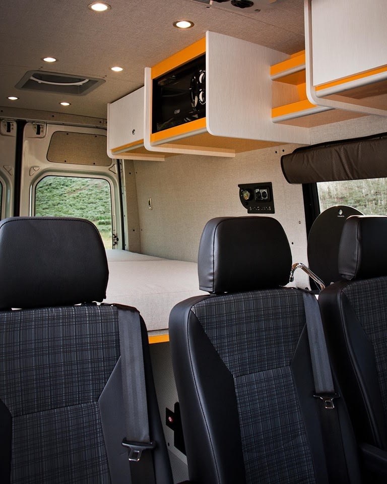 Three removeable jump seats (one with carseat latch anchors) allow for maximum versatility.  Overhead built-ins include two large storage cabinets, two shelves, and a microwave.  The queen mattress comfortably sleeps two adults but can be folded up for additional space or removed altogether.. Mercedes-Benz Sprinter 2017