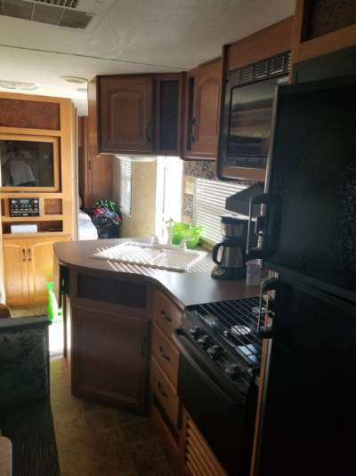 Nice, clean kitchen includes larger refrigerator with separate freezer, stove, and microwave. . Keystone Hornet Hideout 2011
