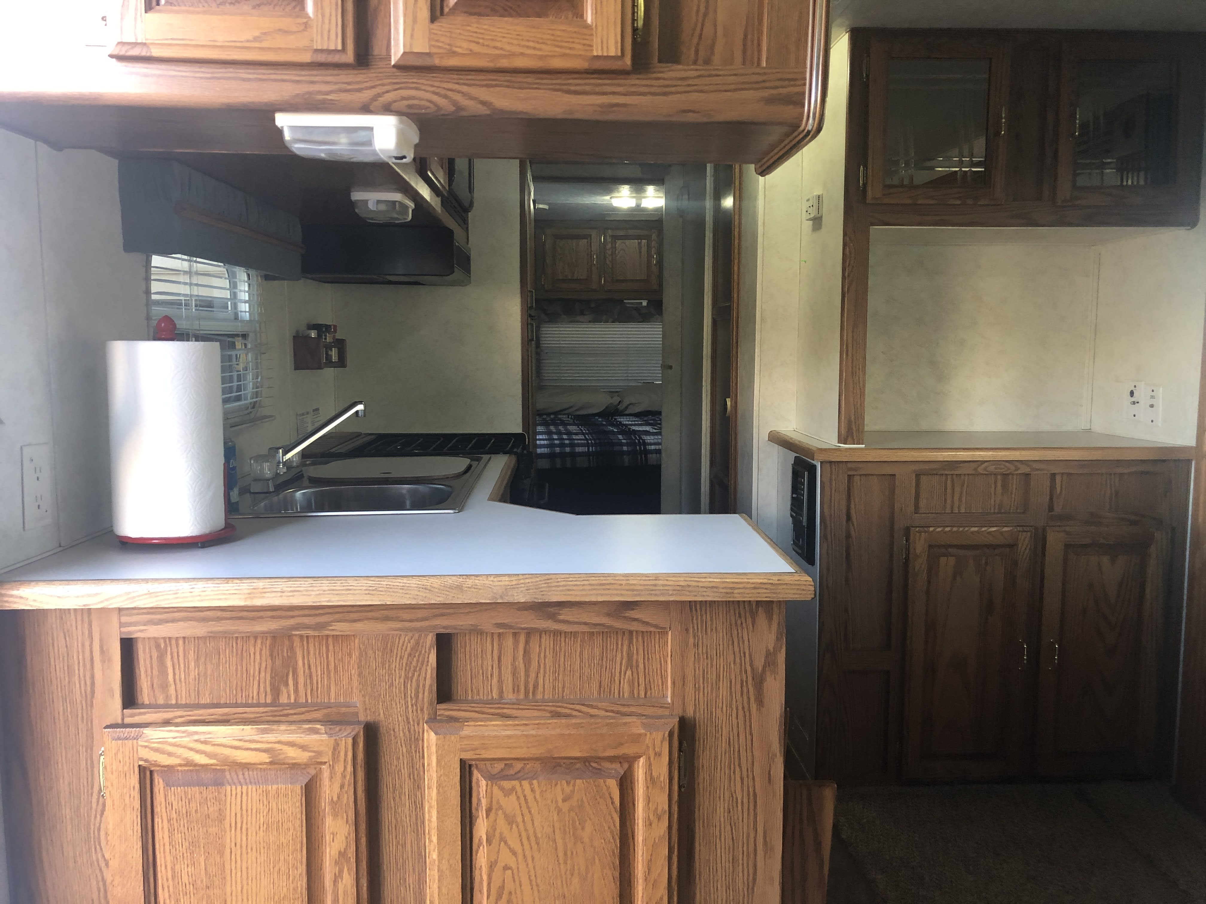 The spacious kitchen and dining area.  Stainless steel sink, 4 burner stove, and a microwave make this kitchen a perfect base camp.. ForestRiver Sierra 2003