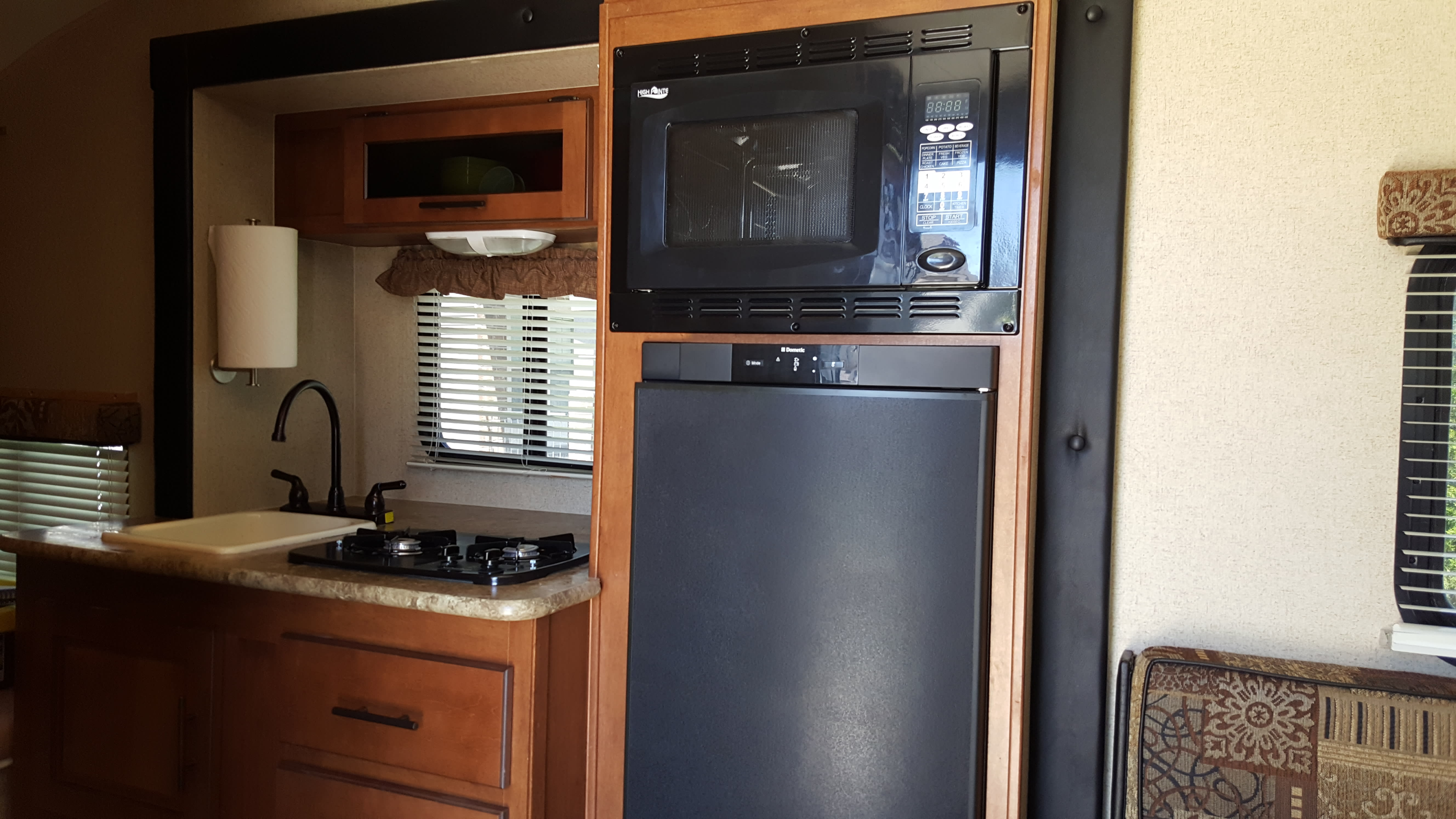 Two burners, sink, microwave, and fridge.. Forest River R-Pod 2013
