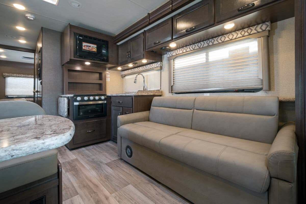 Family sitting area.  Pull out sleeper sofa.  . Thor Motor Coach Four Winds 2019