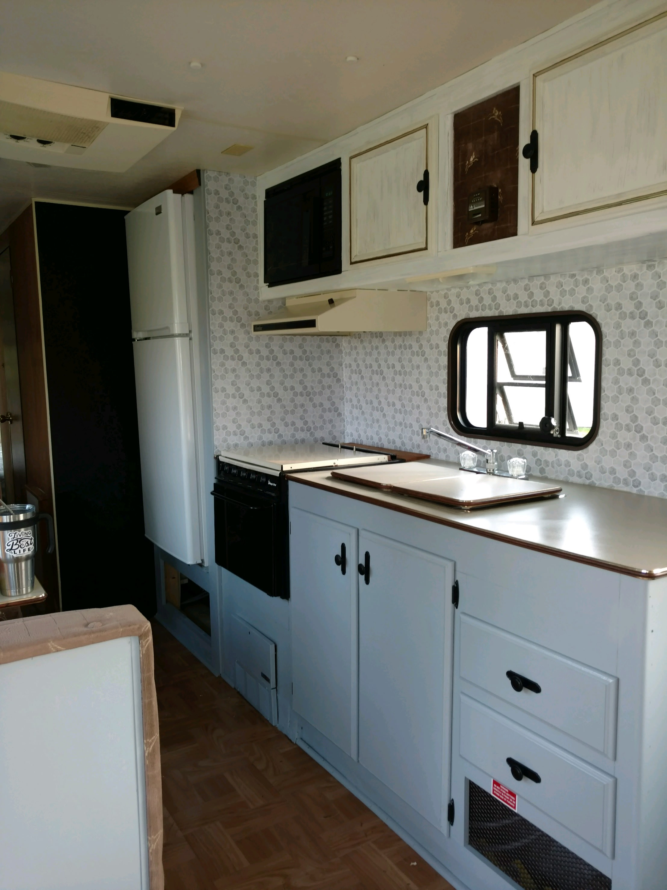 Eat - In dinette with great views.  Extra large refrigerator, microwave, stove, coffee pot, pots, pans, dishes, glassware, utensils, small grill, picnic table in pavilion conveniently located adjacent to RV. Fire ring available, wood at extra charge.  . Sportsmens SD 1993
