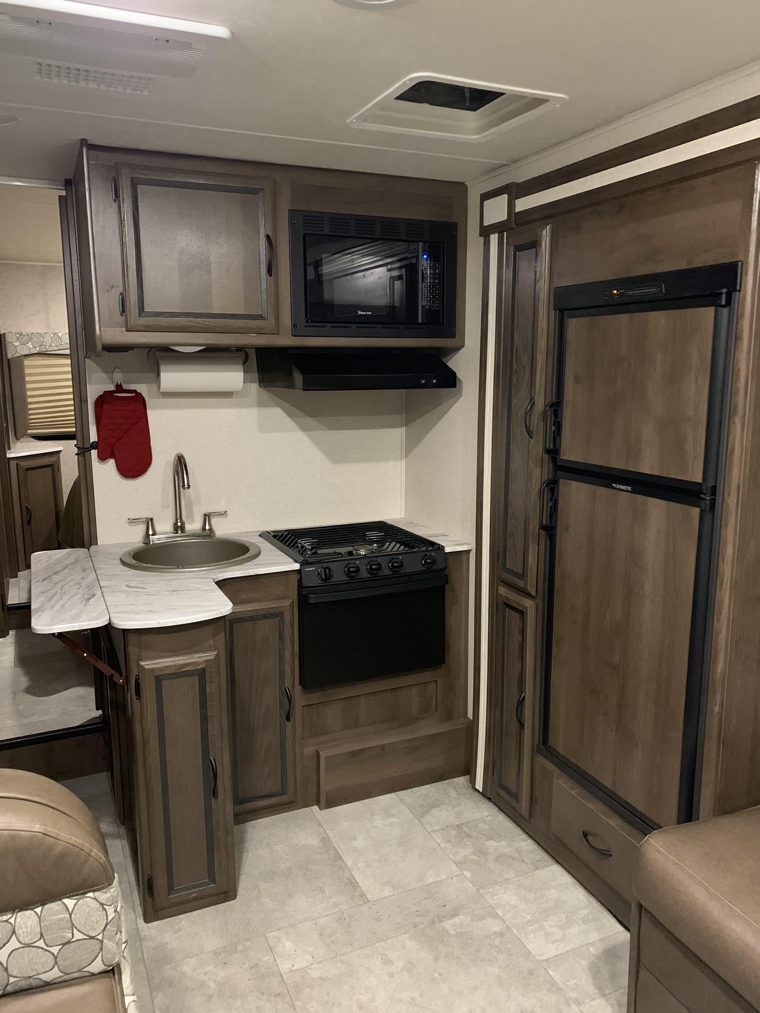 Fully furnished kitchen. Coachmen Freelander 2019