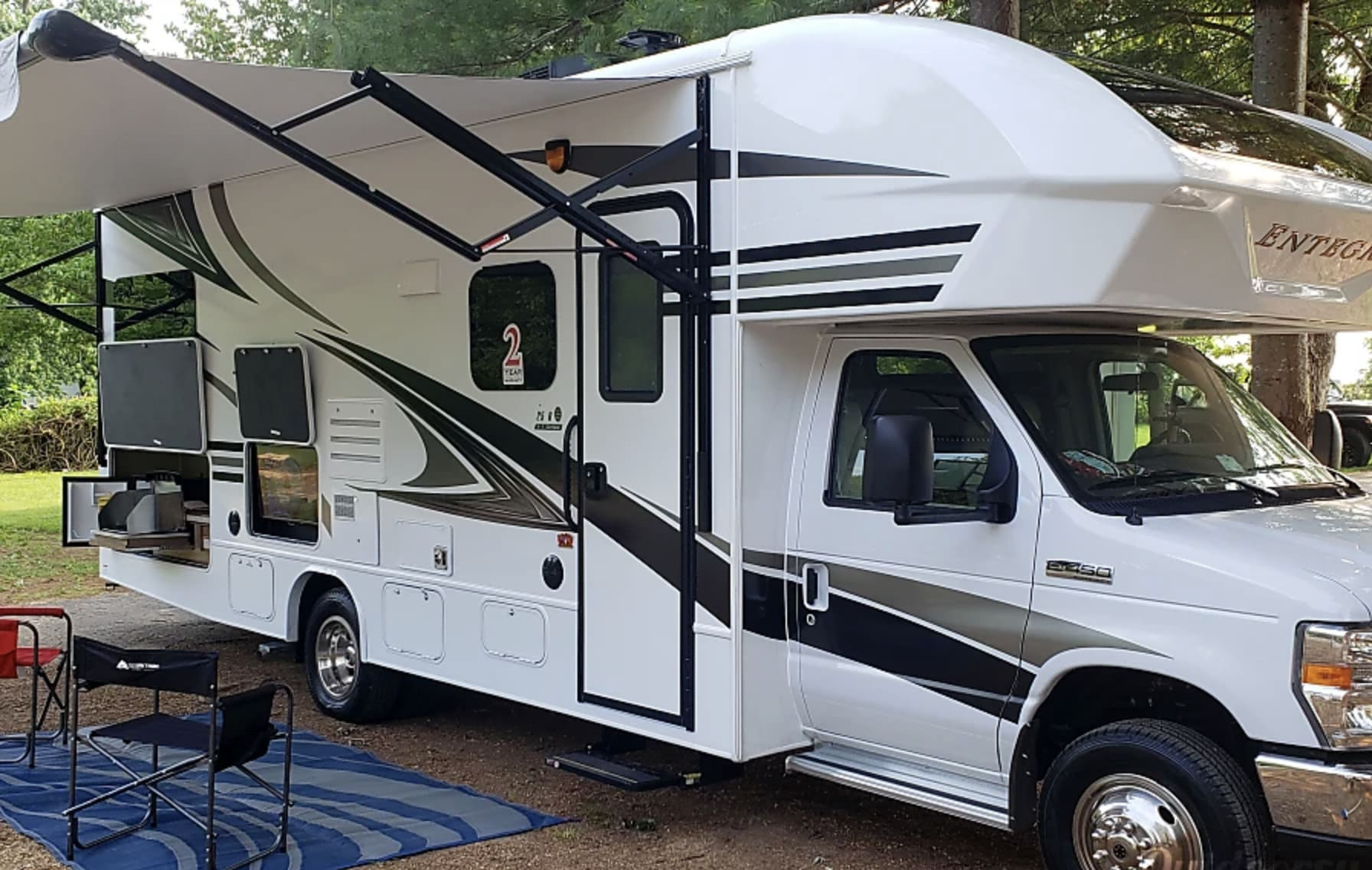 Awning with a Tv and Full outdoor kitchen.. Entegra Coach Other 2019