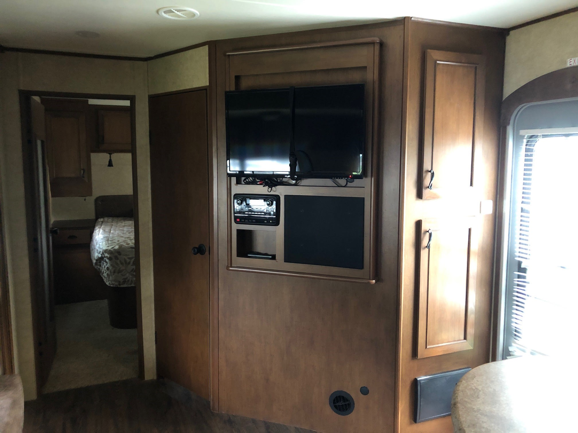Entertainment center includes TV, DVD player and radio available.. Open Range Light 2015