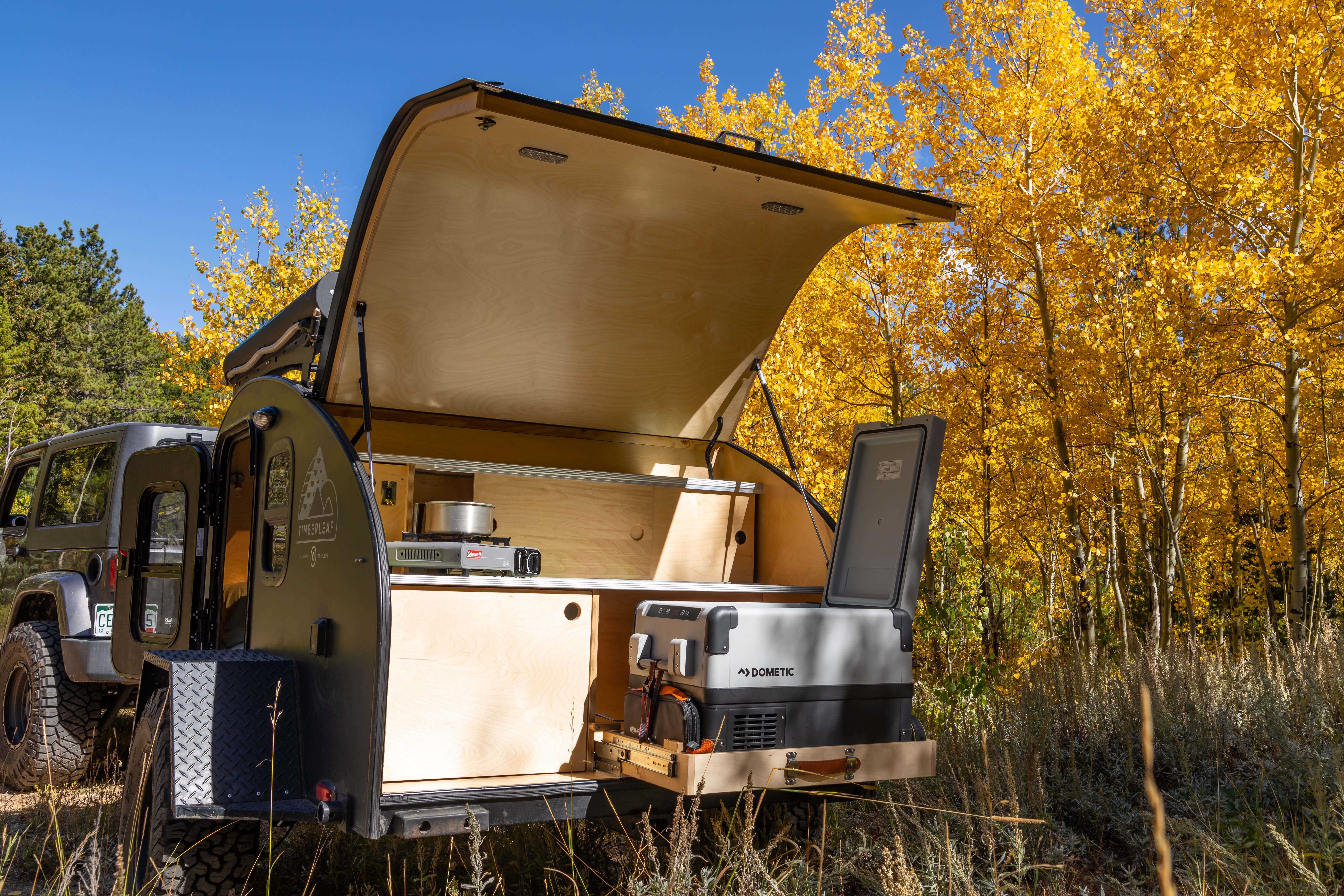 A gas stove, plenty of pantry space, and a fridge/freezer for all your cooking storage and needs. . Timberleaf Pika 2019