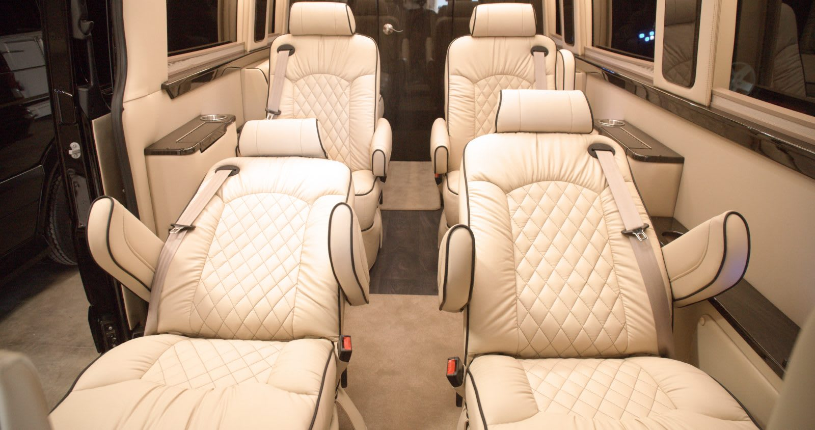 Captains chairs recline and have powered foot rest. Midwest Automotive Designs Presidential 2020