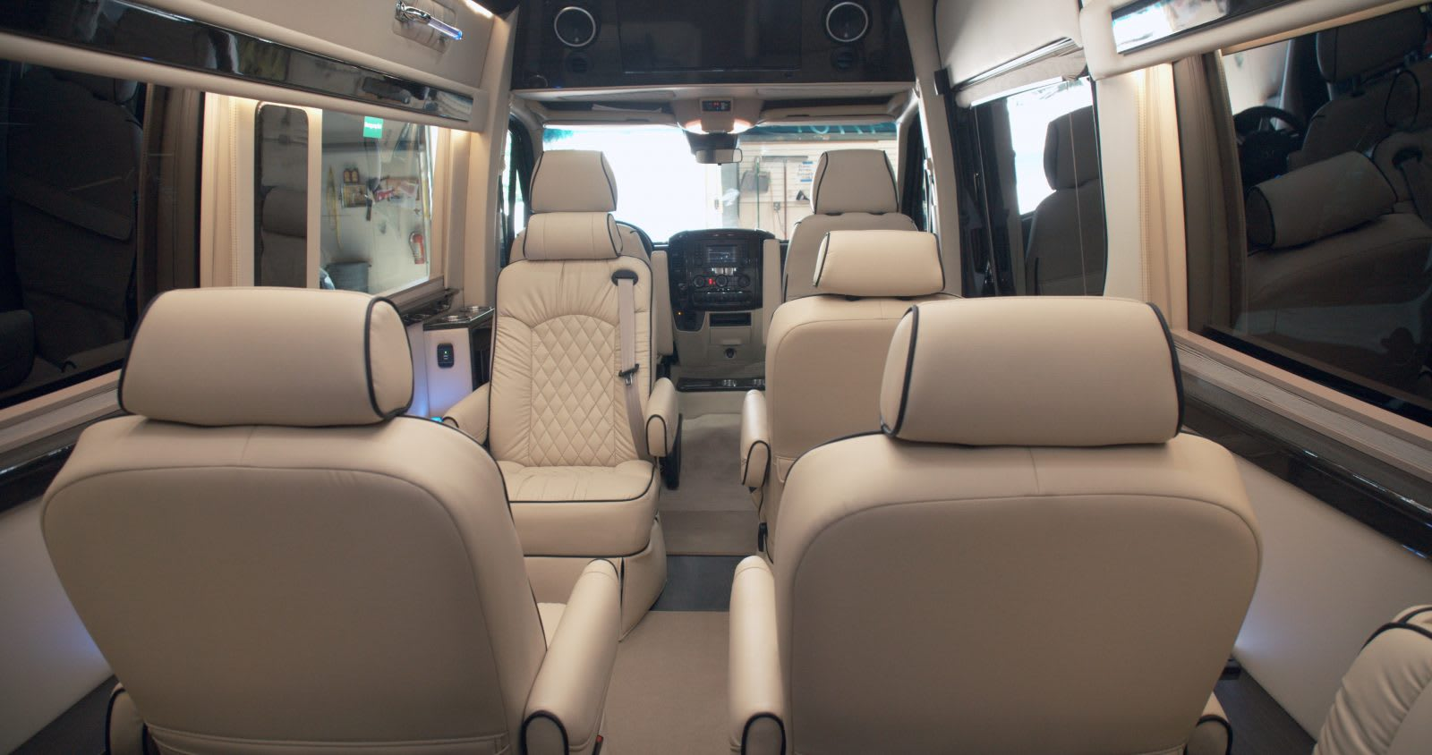 The best in Luxury travel.  4 large captains chairs that can face forward or backward.. Midwest Automotive Designs Presidential 2020
