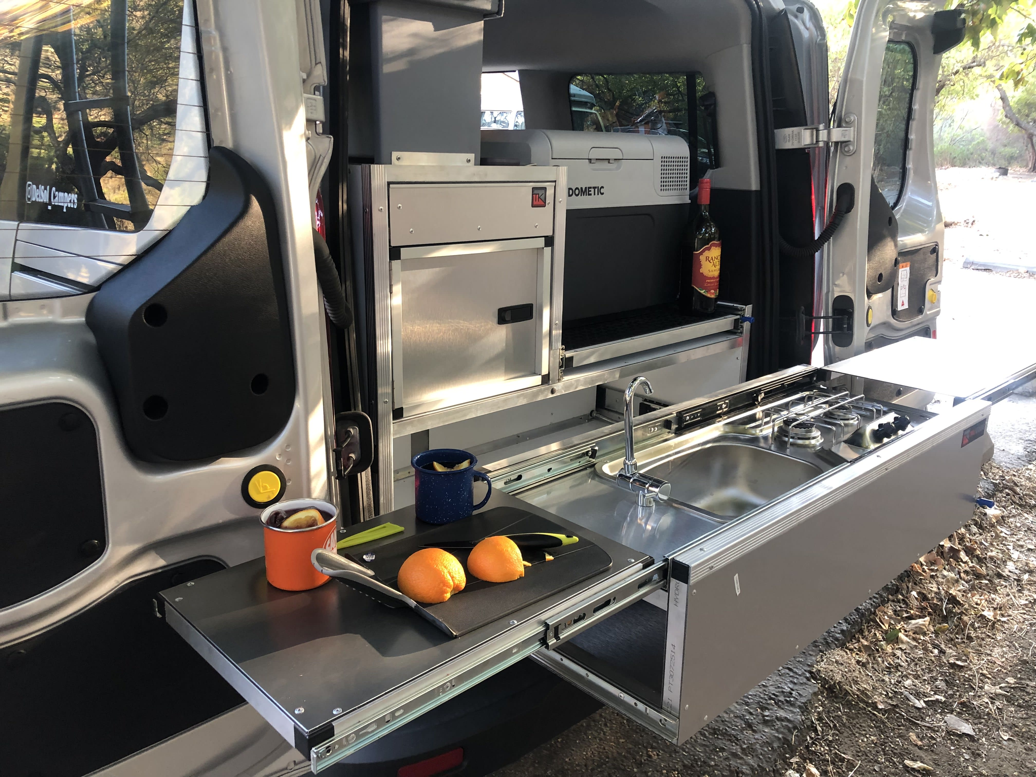 Plenty of counter space for food prep and a powered sink for easy cleanup | Del Sol Campers. Ford Transit Connect Wagon 2016