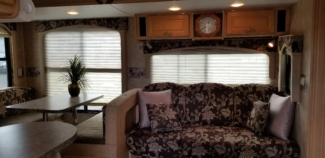 Jack knife couch and table area makes into a bed also. Thor Motor Coach Jazz 2008