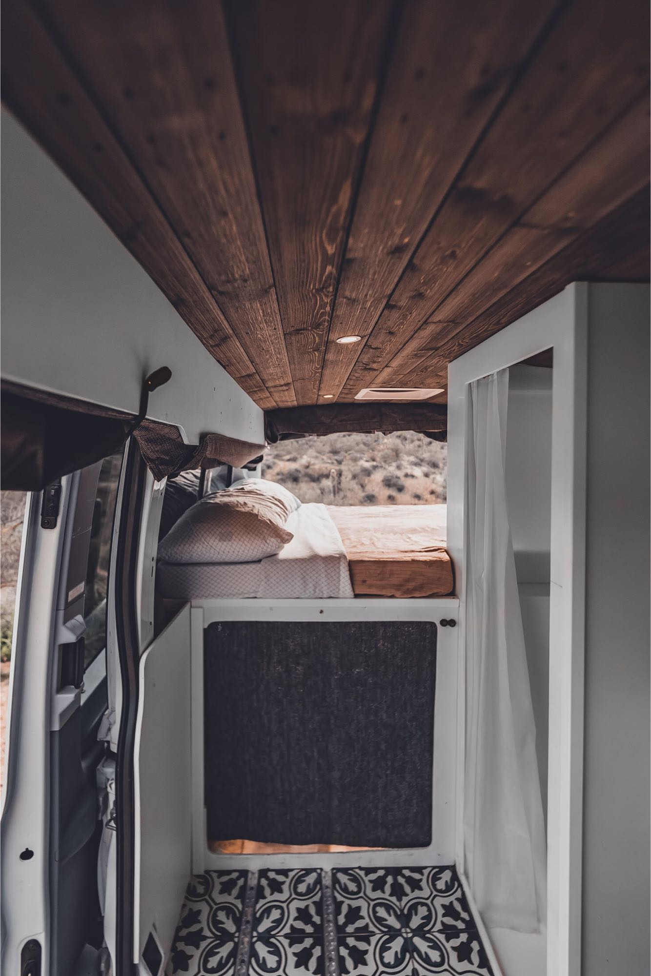 Large comfortable bed, distressed barn wood ceiling. Ford Transit 2015