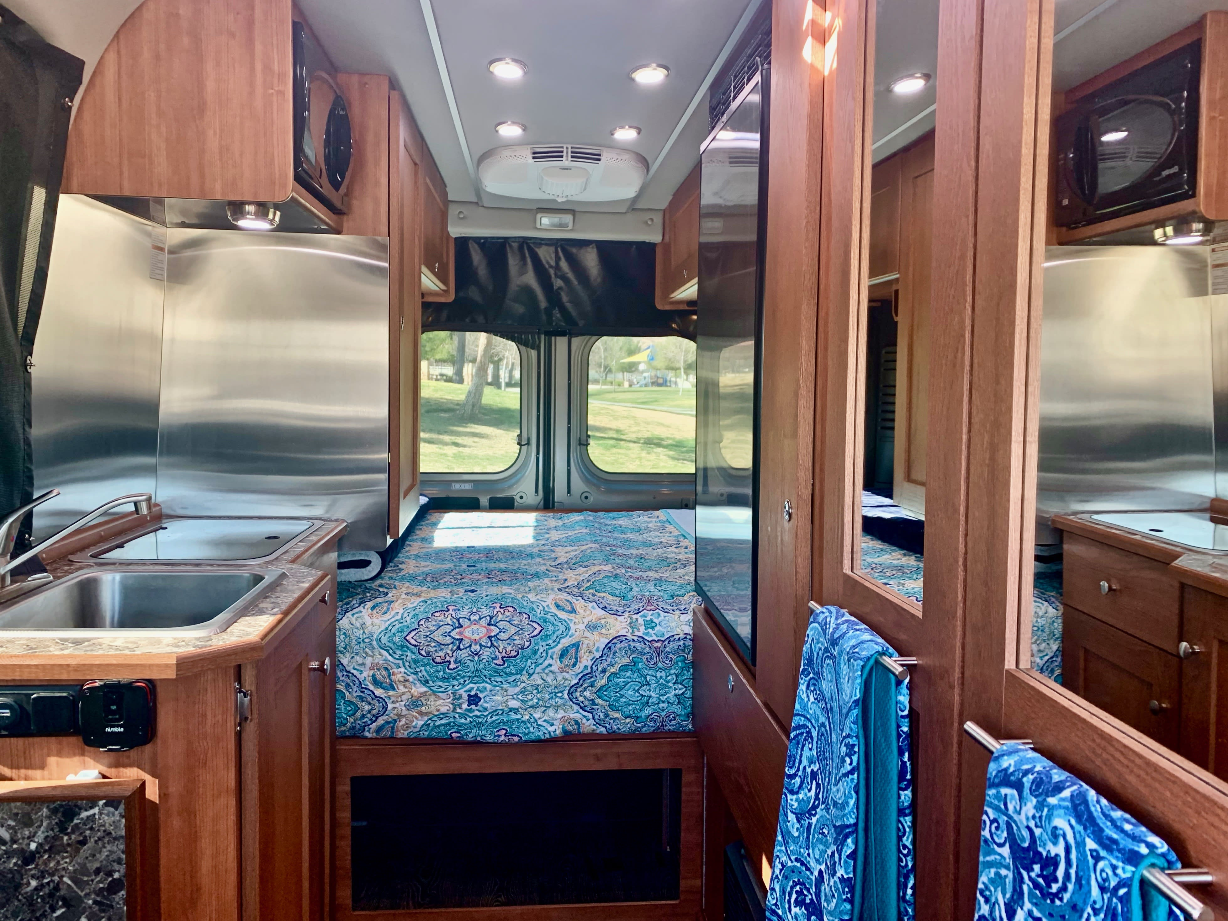 Bright Interior with Plenty of LED Lighting, Propane Heater, and AC (while attached to Electrical Hookups). Roadtrek Roadtrek 2019