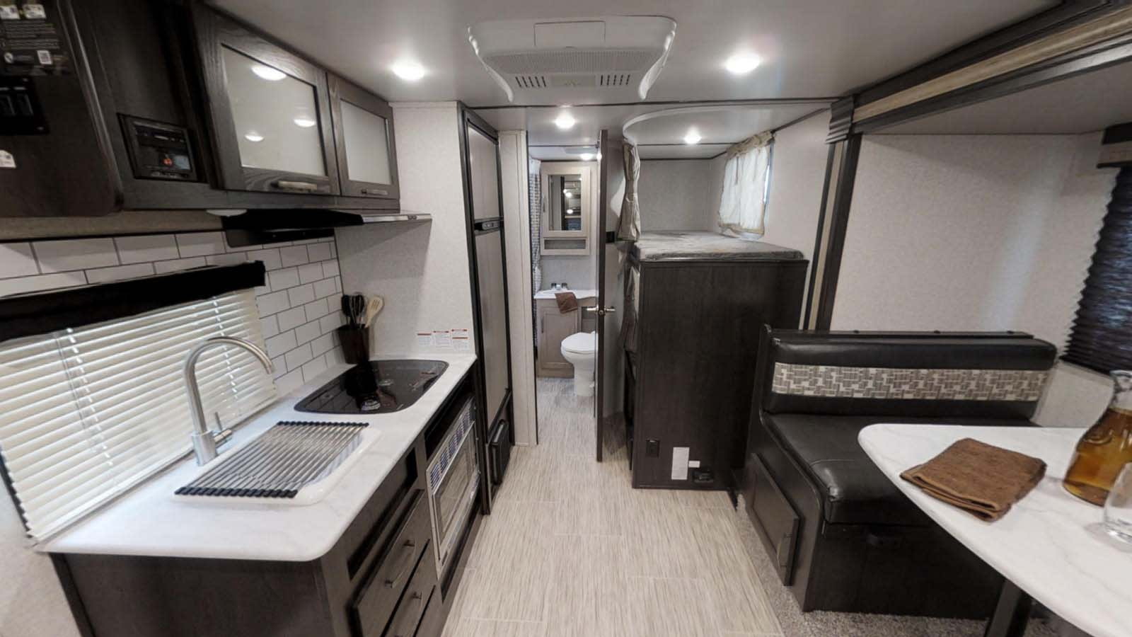 Slide out provides ample interior space in this lightweight camper!. Forest River Surveyor 2021