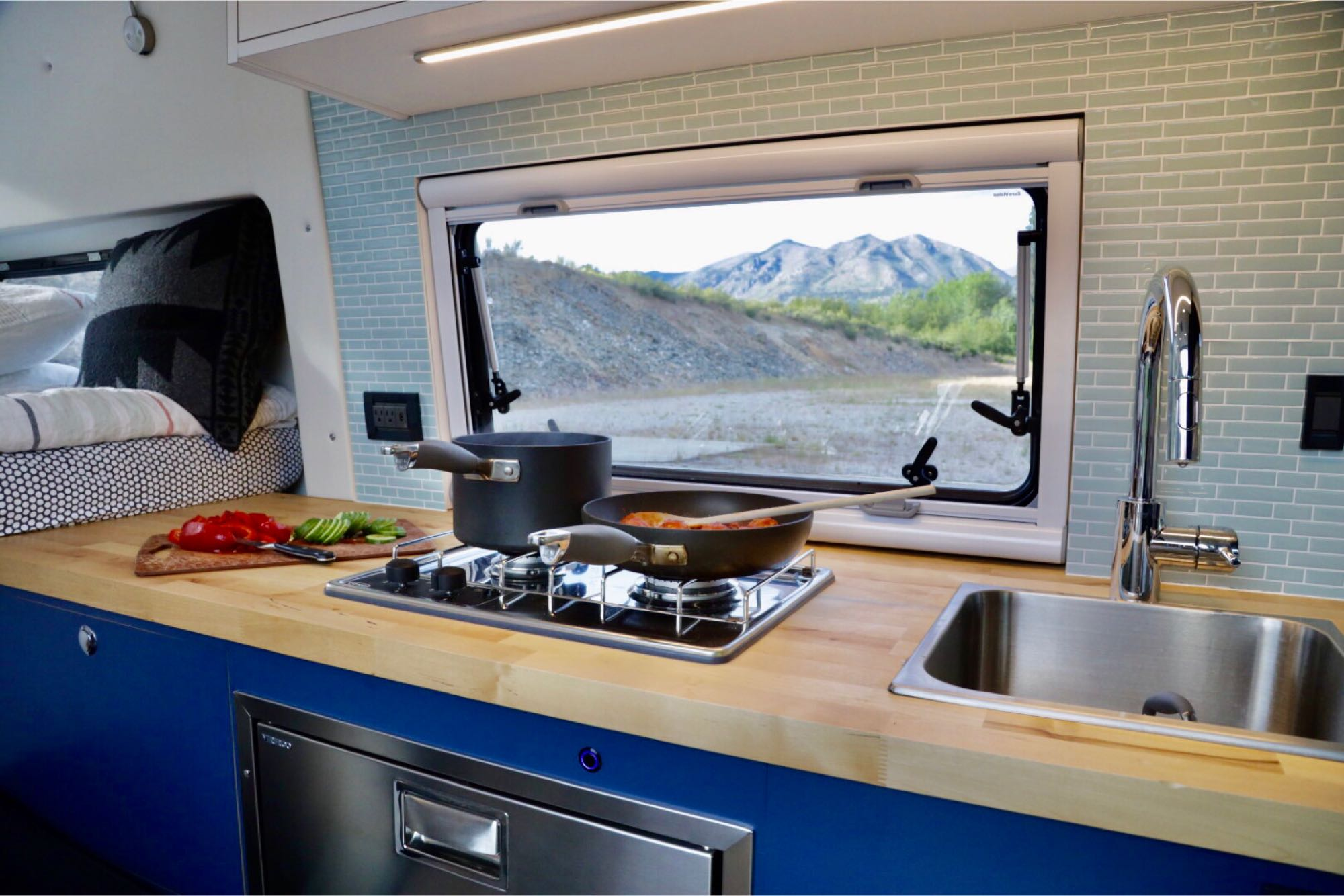 2-burner propane cooktop and a deep sink with faucet. Mercedes-Benz Sprinter 2019