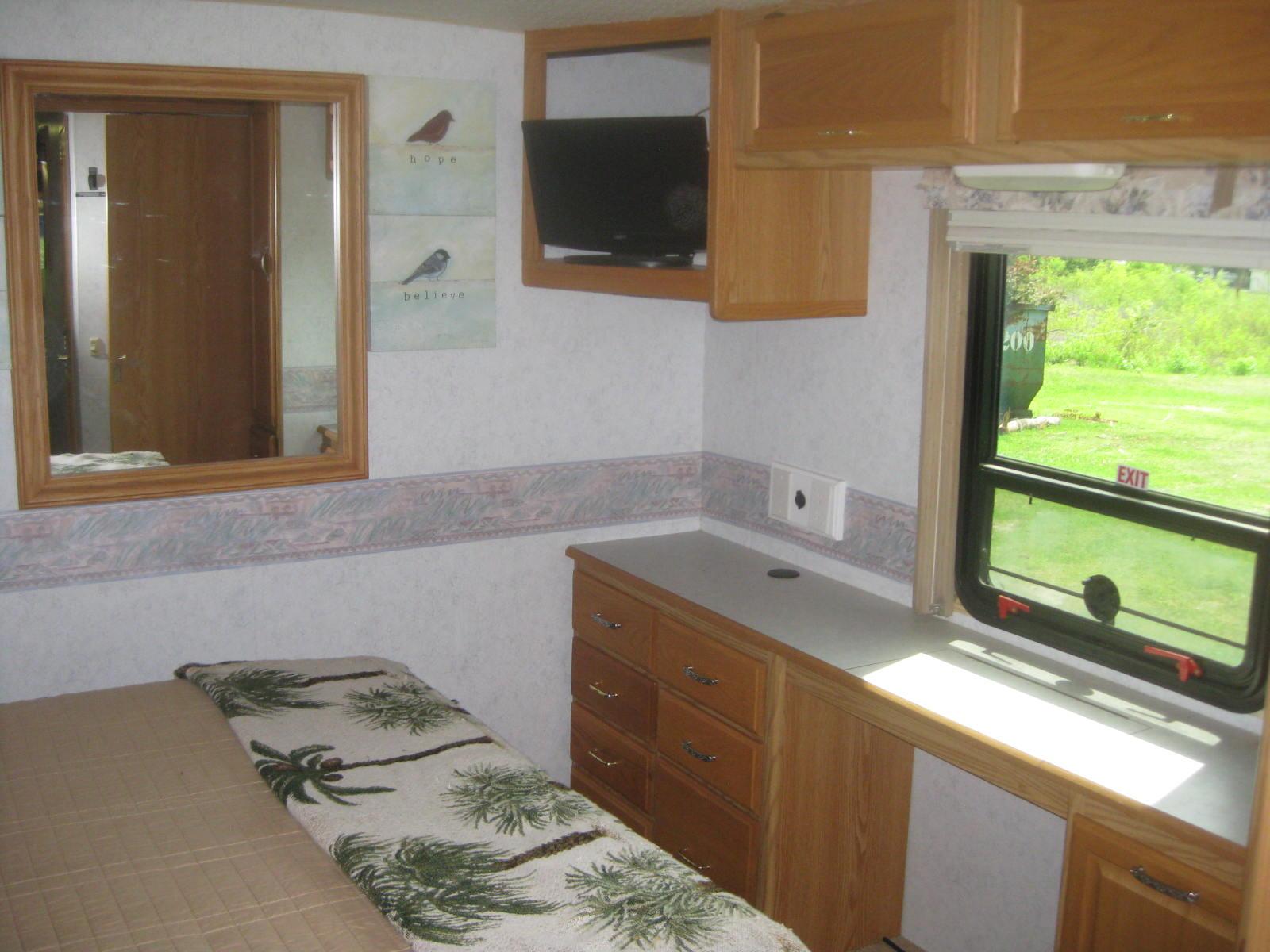 Master bedroom window. Winnebago Adventurer 2003