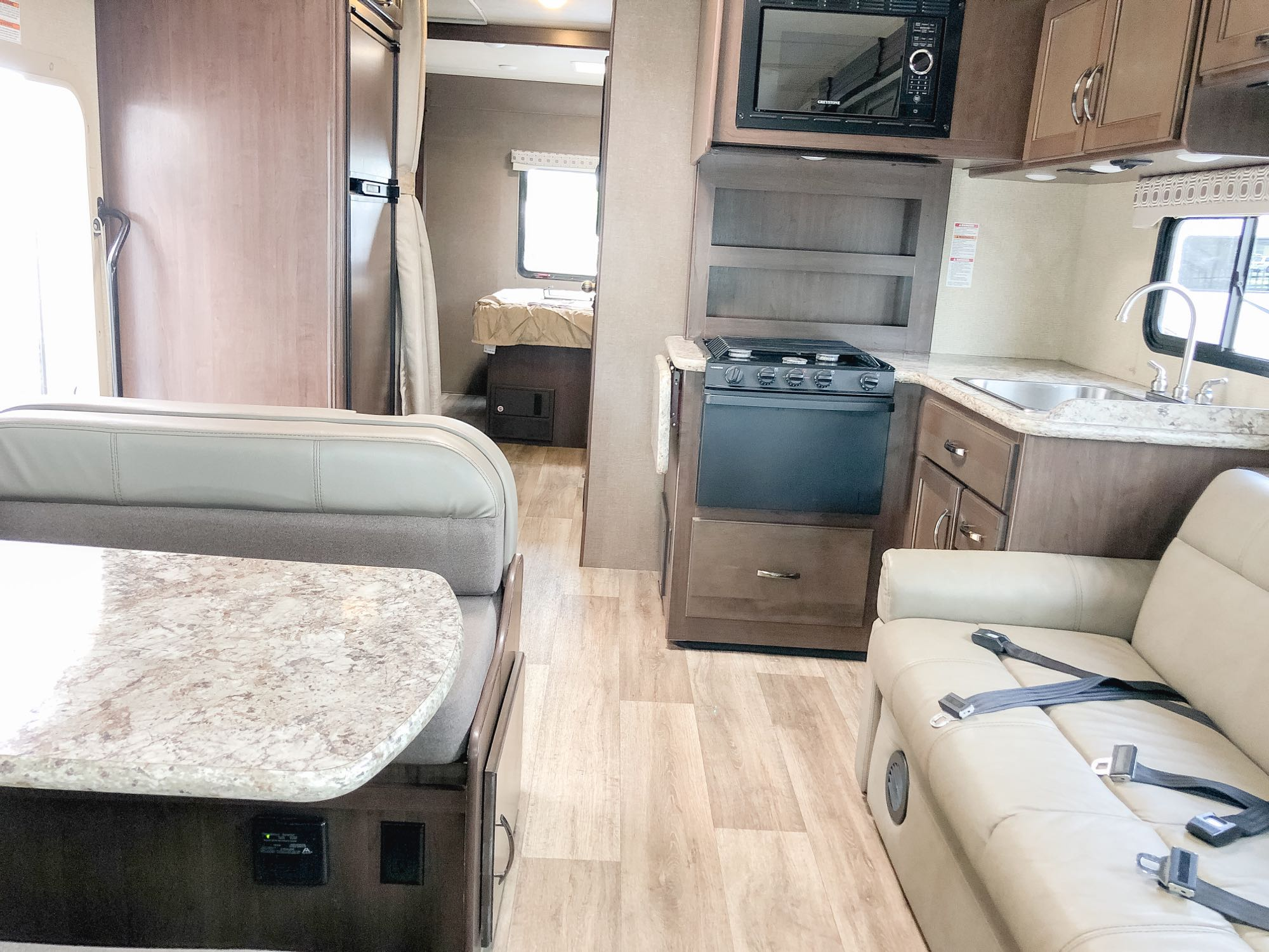 Plenty of room to separate with 13 seats with 7 dedicated seat belts. Thor Motor Coach Four Winds 2019