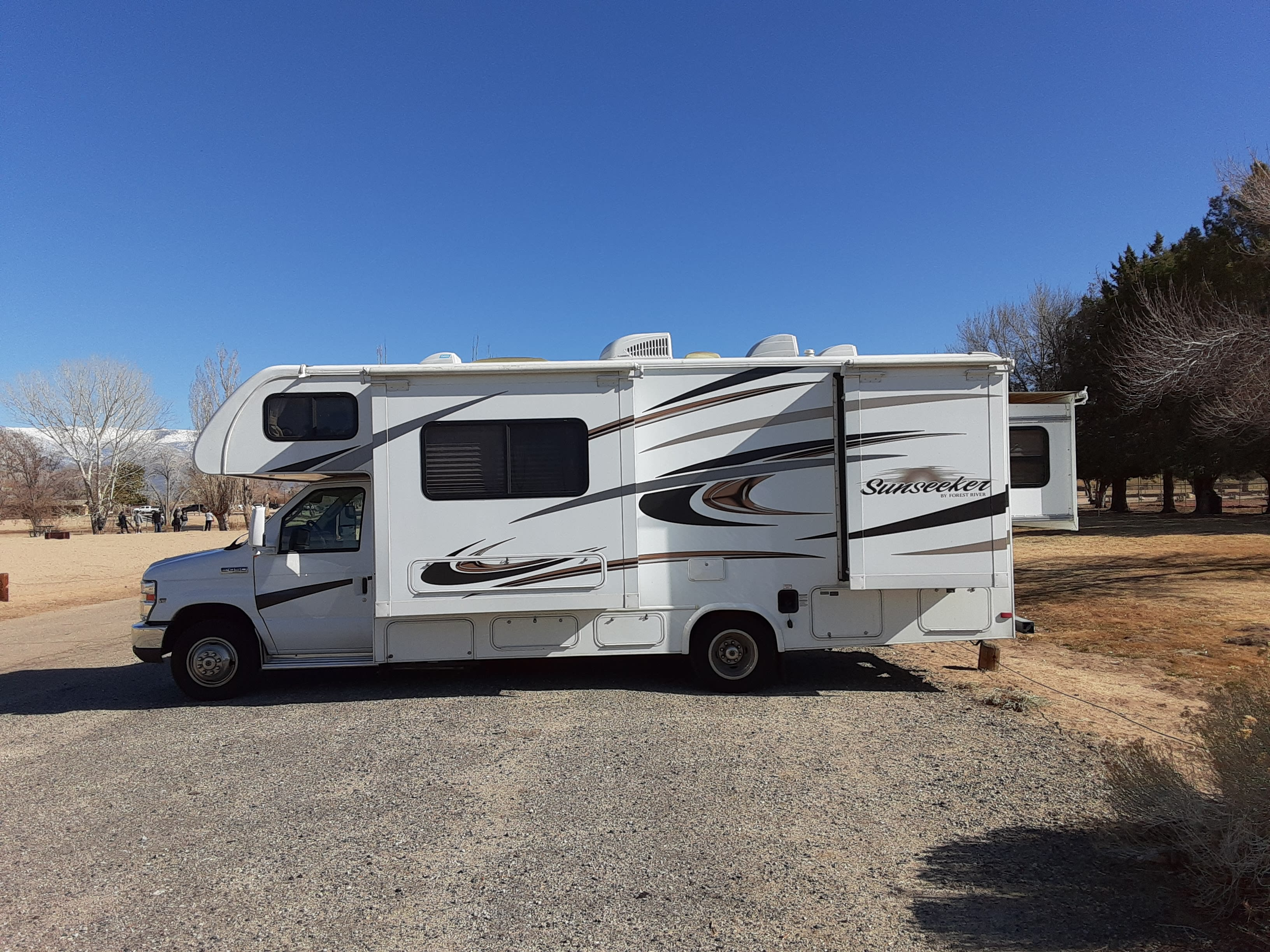 3 slide outs which extend the dining and master bedroom as well as the wardrobe closet.. Forest River Sunseeker 2014