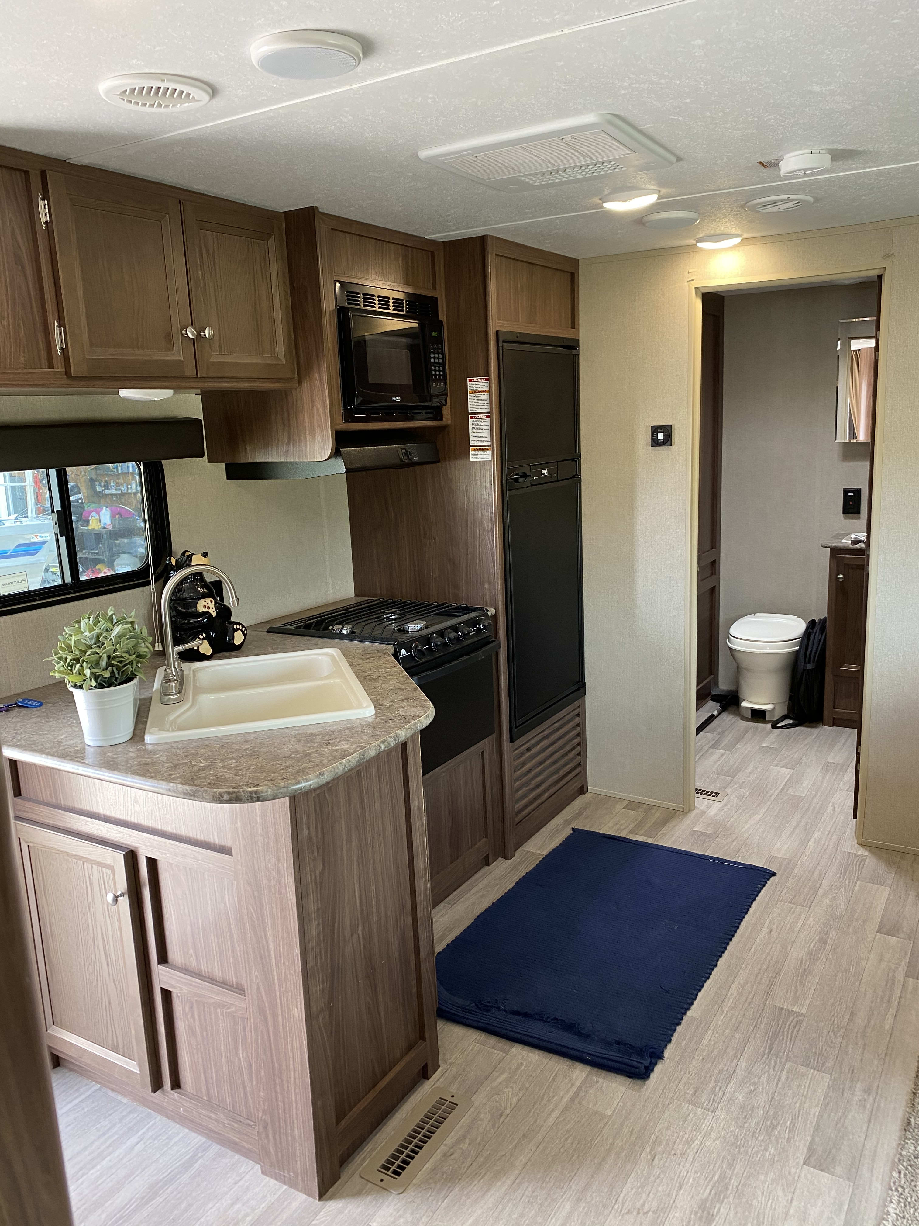 Great kitchen space with large counter area, double sided sink, 3 burner stove, microwave and fridge/freezer. Dutchmen Coleman 2017