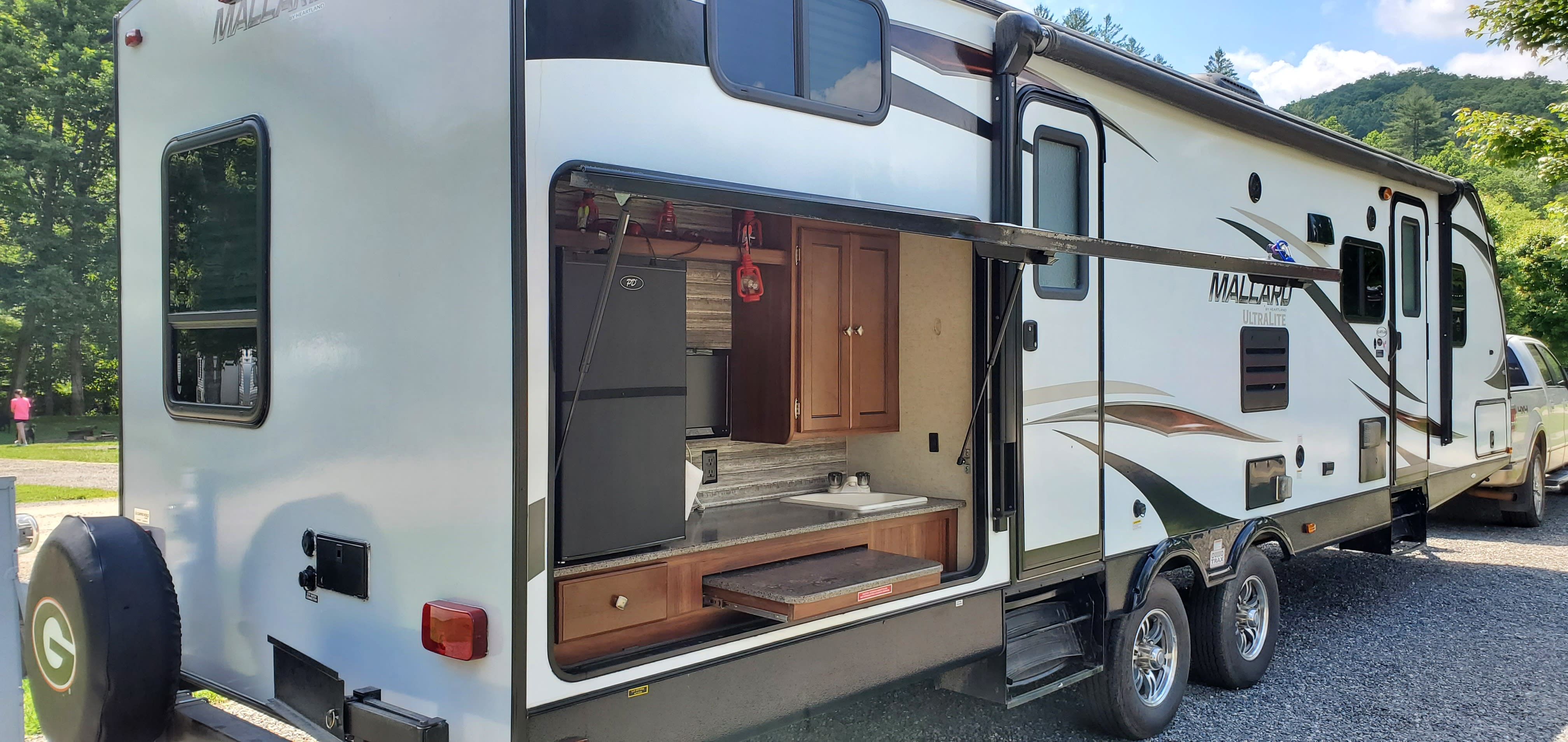 32 foot bunkhouse camper with outdoor kitchen and gas grill.. Heartland Other 2017