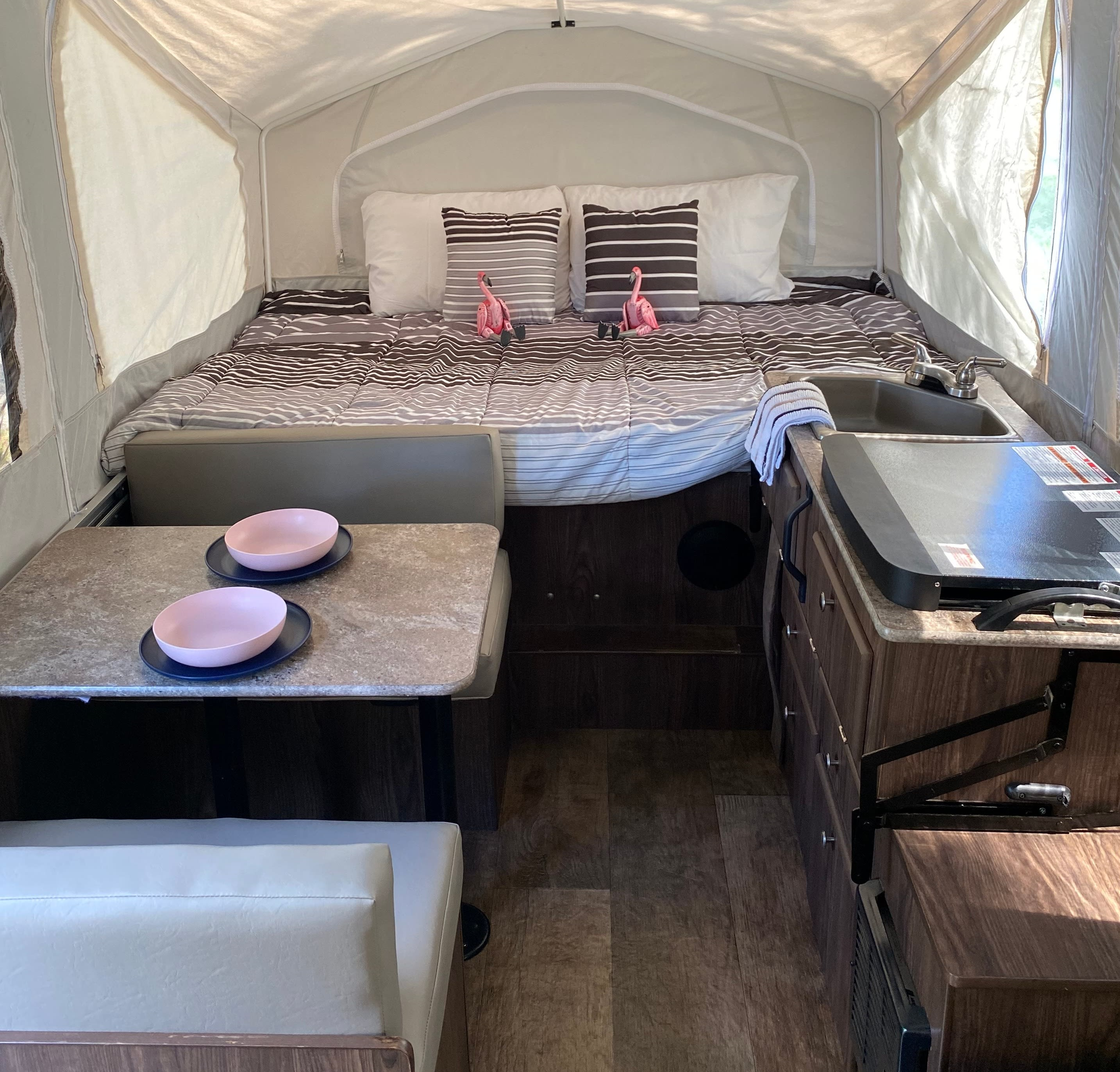 Full bed with kitchenette and dining table. ForestRiver Flagstaff 2017