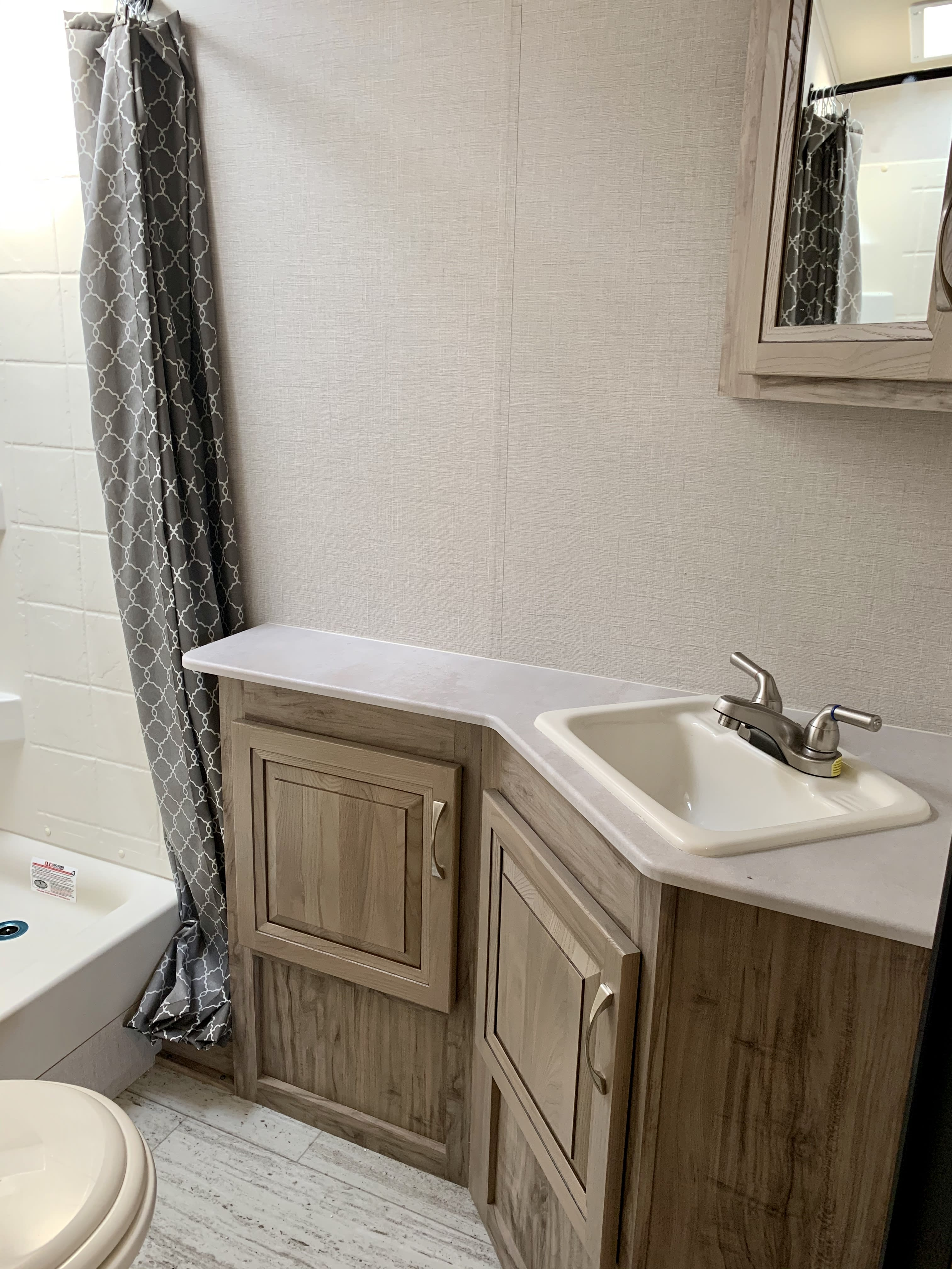 Spacious sink with plenty of storage.. Palomino Solaire Ultra Lite 2019