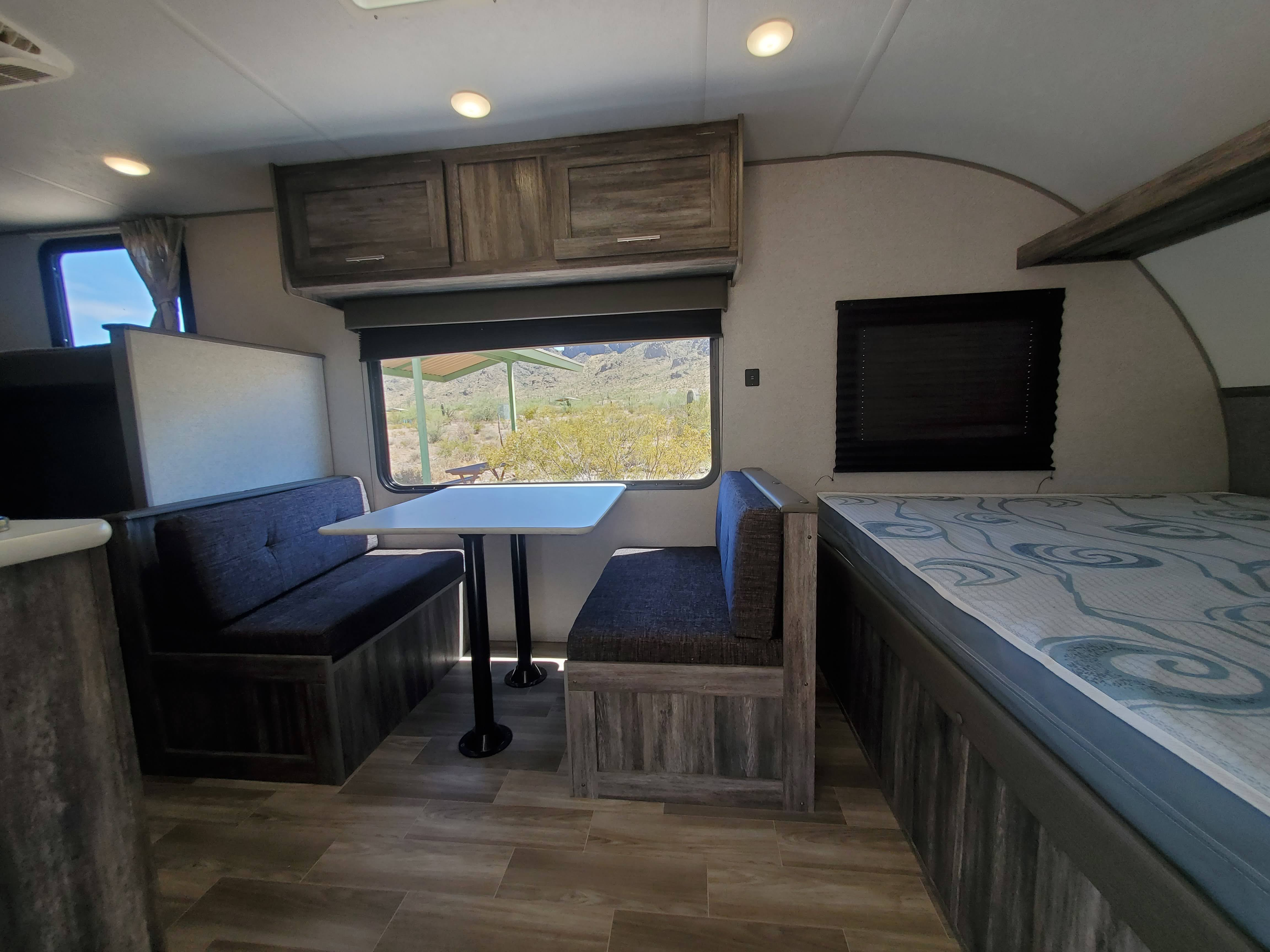 Dinette is a very nice place to sit and converts into a bed that can sleep one adult or two children. The queen bed has its own window.. Forest River Salem 2019
