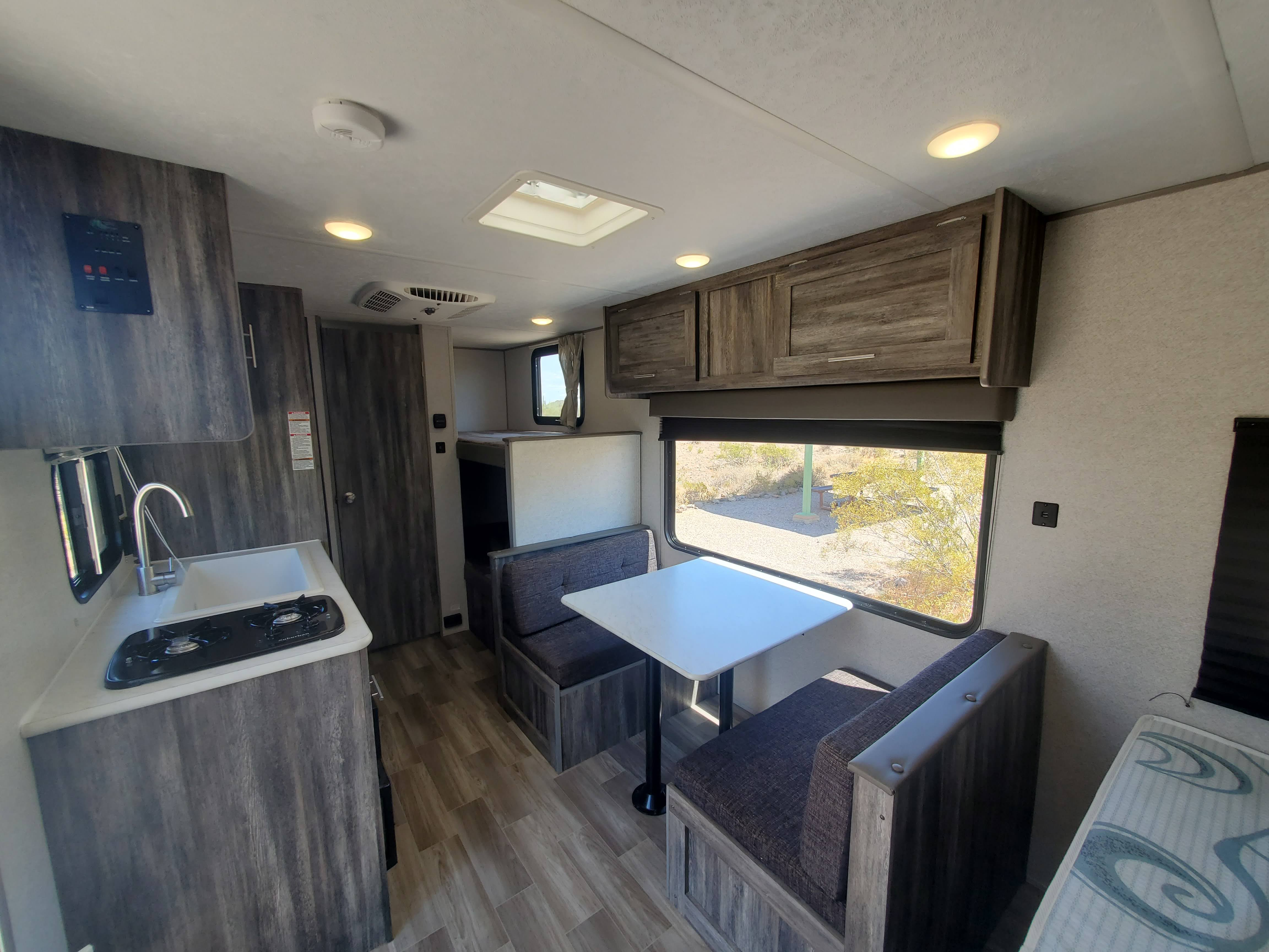 View that greets you when you walk in the trailer. Lots of natural light through the oversized dining window. Forest River Salem 2019