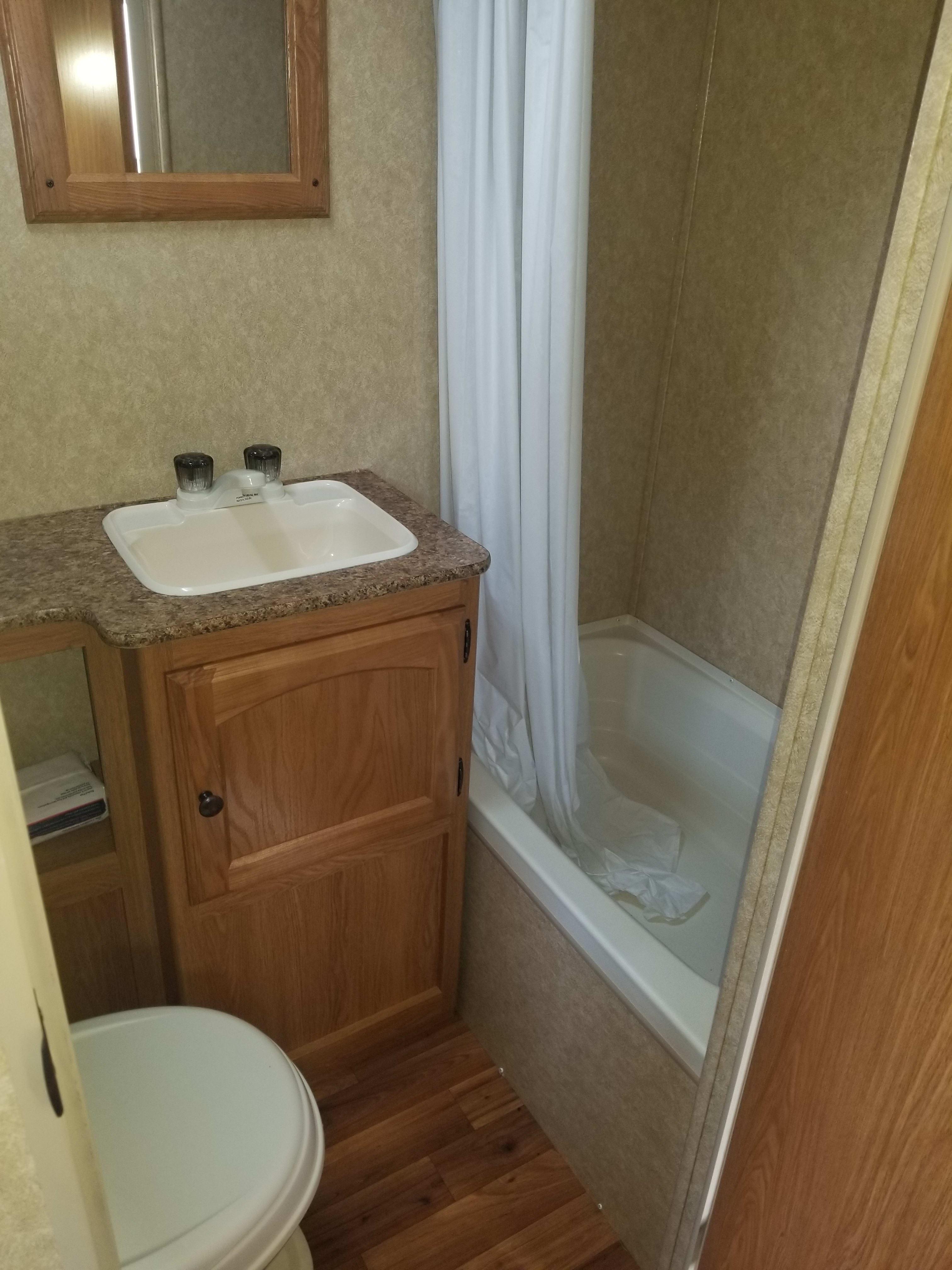 Bathroom with shower. Dutchmen Coleman 2012