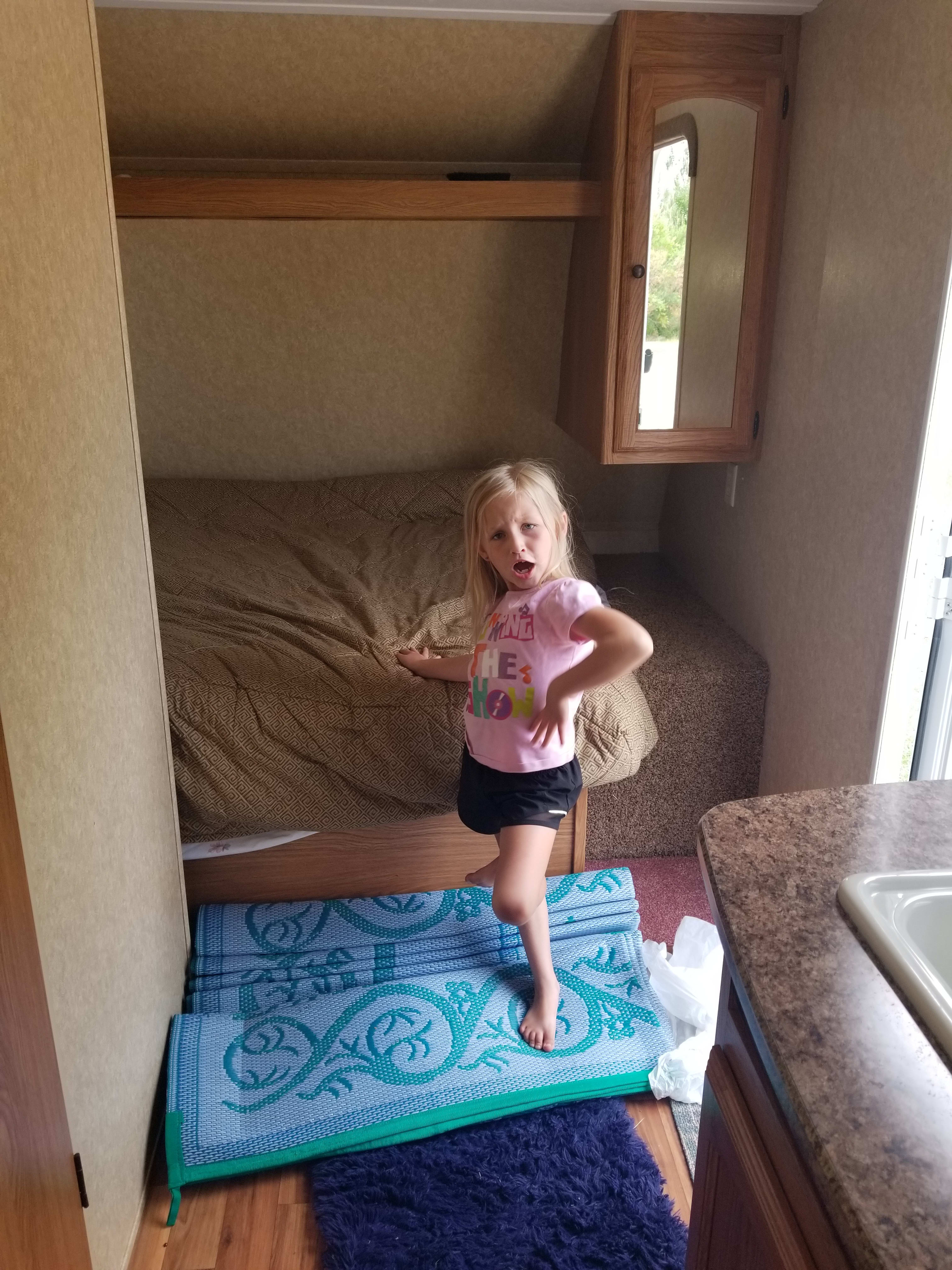 Full size bed, child not included. Dutchmen Coleman 2012