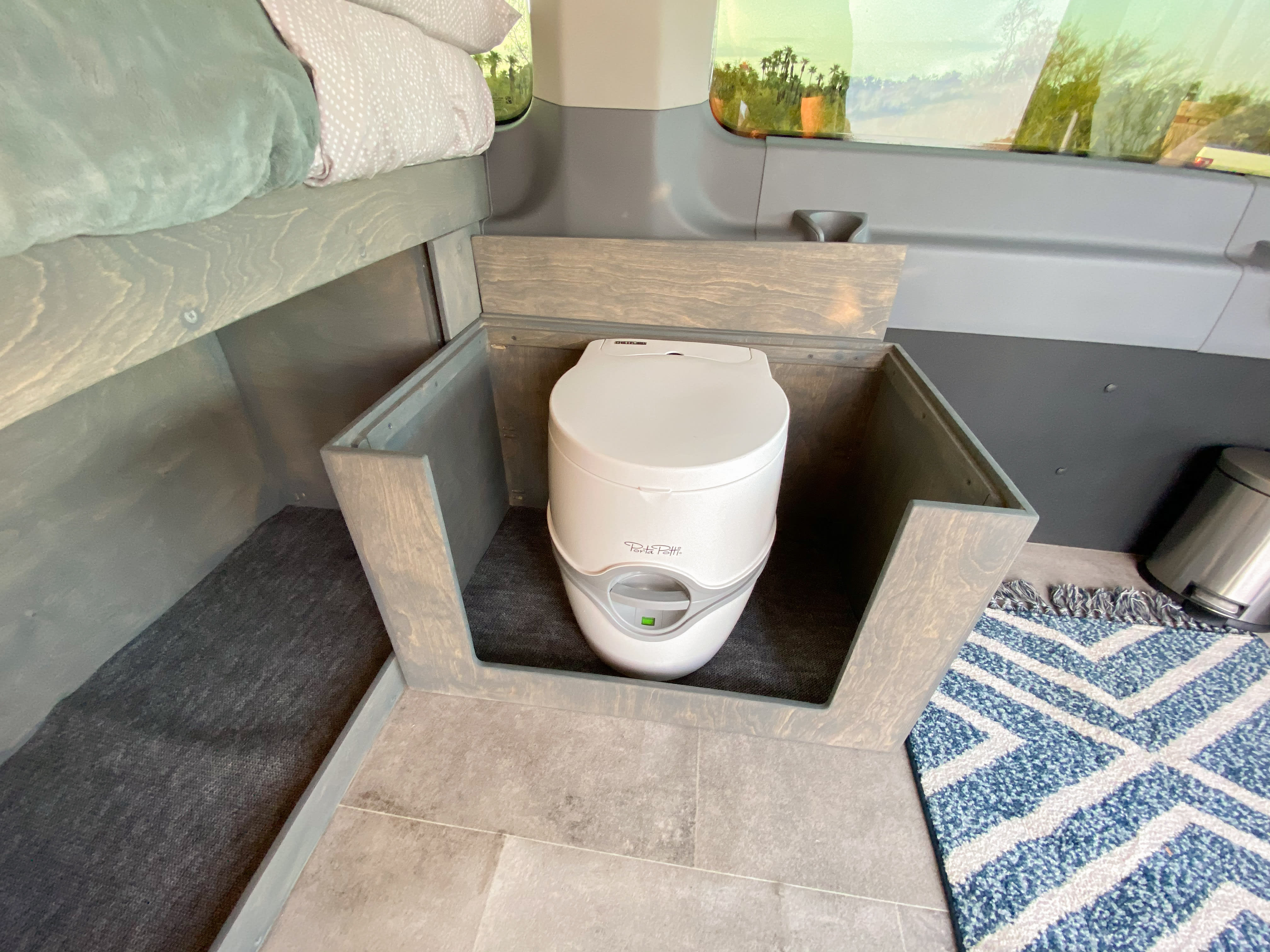 Porta Potti cassette toilet offers convenience and ease of use.. Ford Transit Camper Van 2017