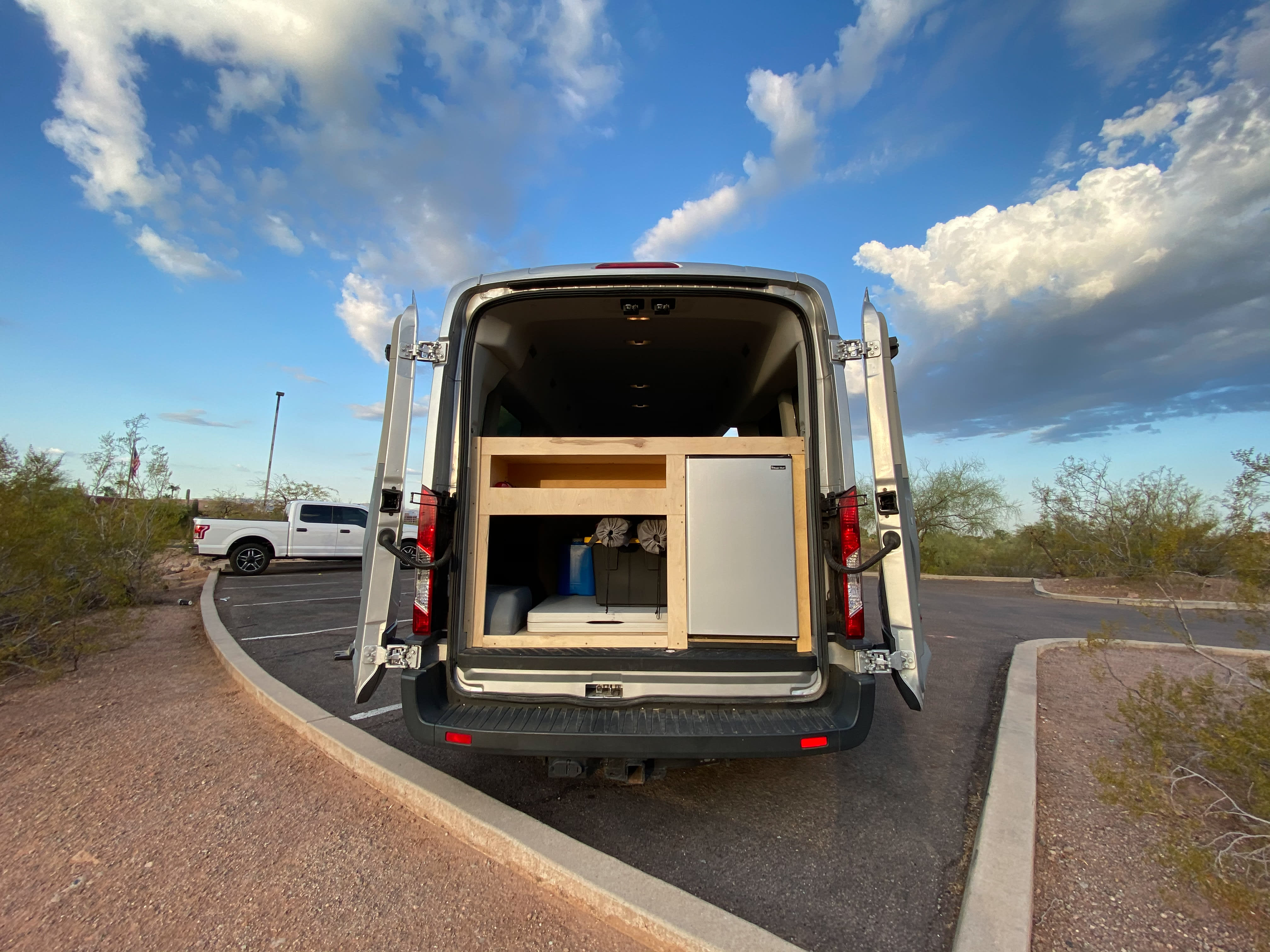 Large rear accessible fridge and plenty of storage for your trip. . Ford Transit Camper Van 2017