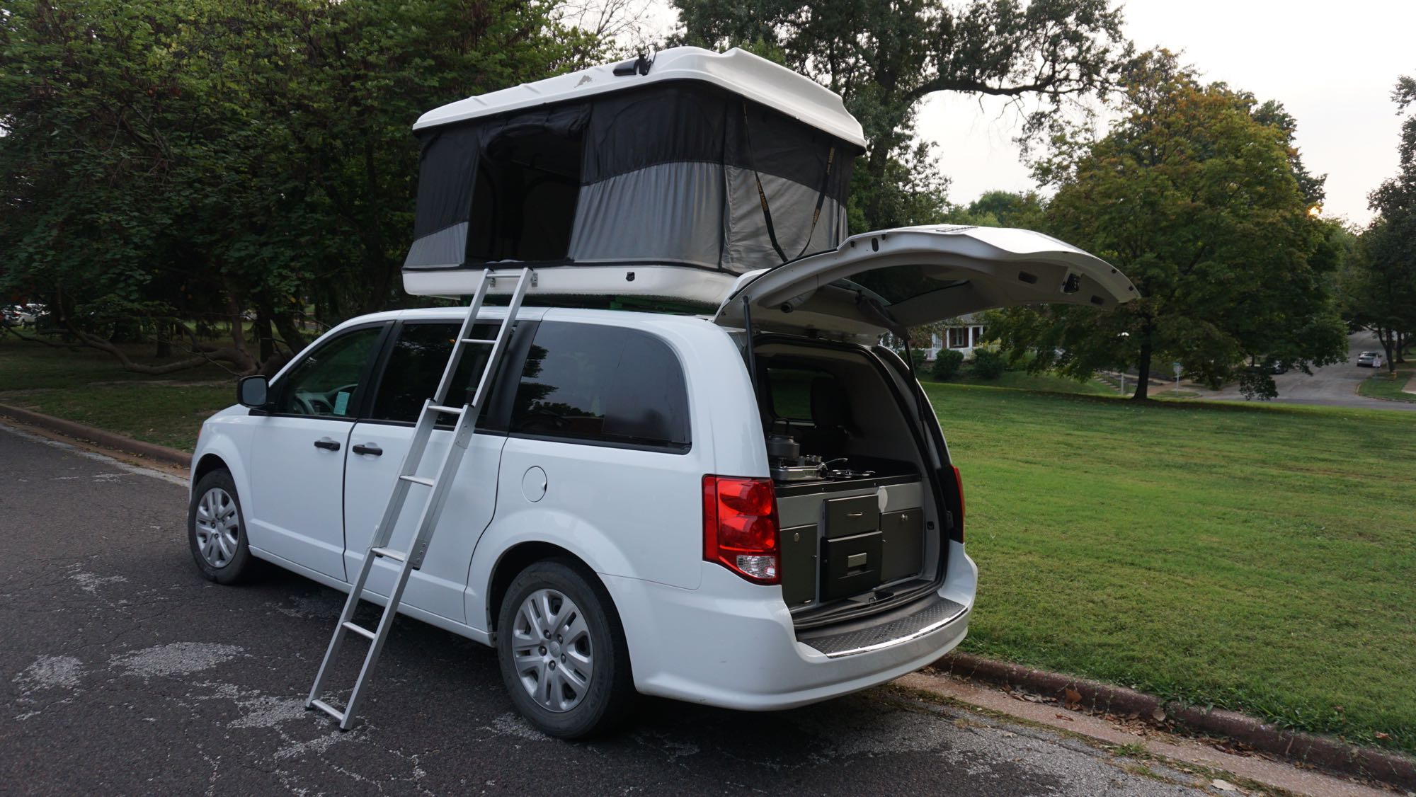 The van comfortably sleeps four and includes a kitchen. Dodge Other 2019