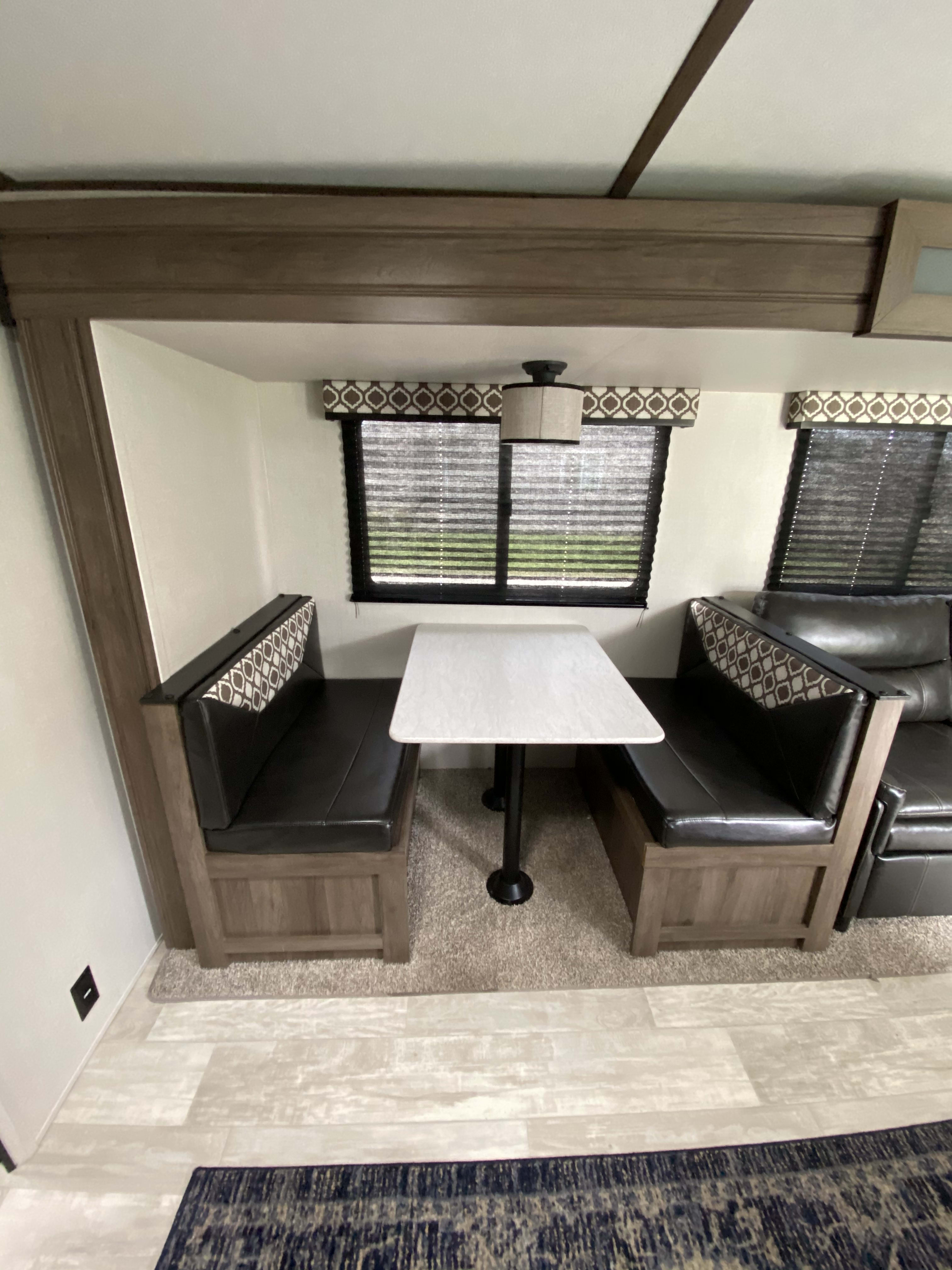 Dinette, fits 4 comfortably, also turns into bed. Forest River Tracer 2020