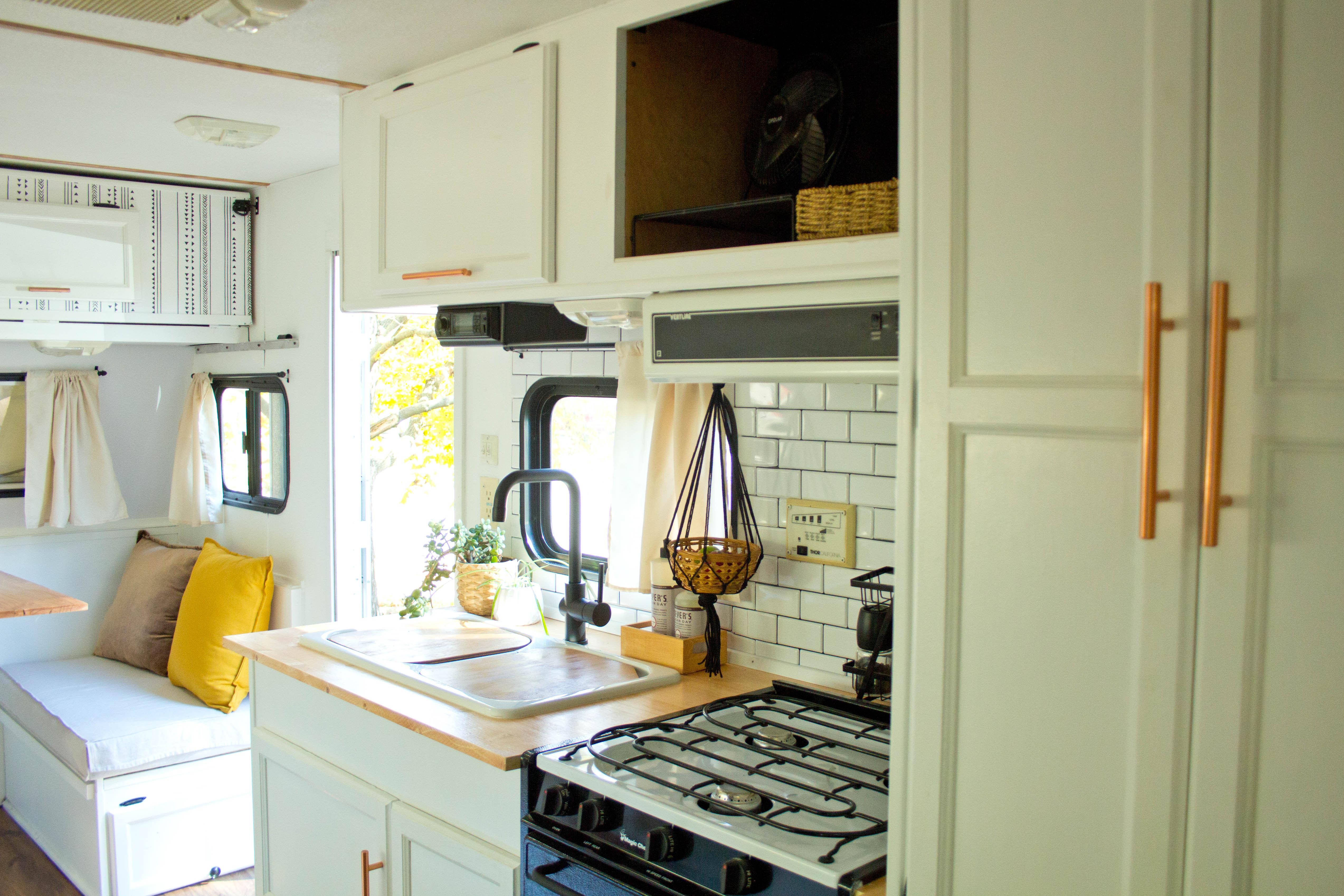 Kitchen, wardrobe, and dinette view from bed. Thor Motor Coach Tahoe 2001