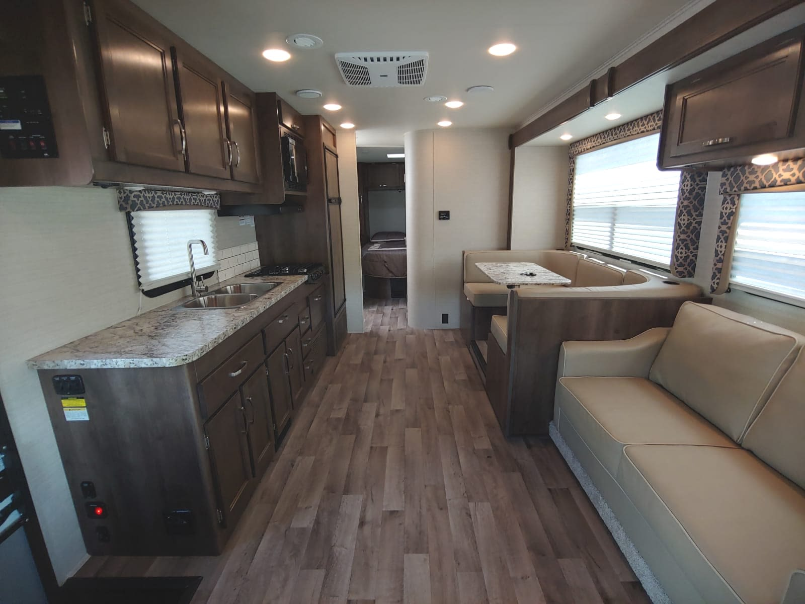 Interior of motor home, seating, dining, and kitchen areas - slide-out extended!. Jayco Redhawk 29XK 2019
