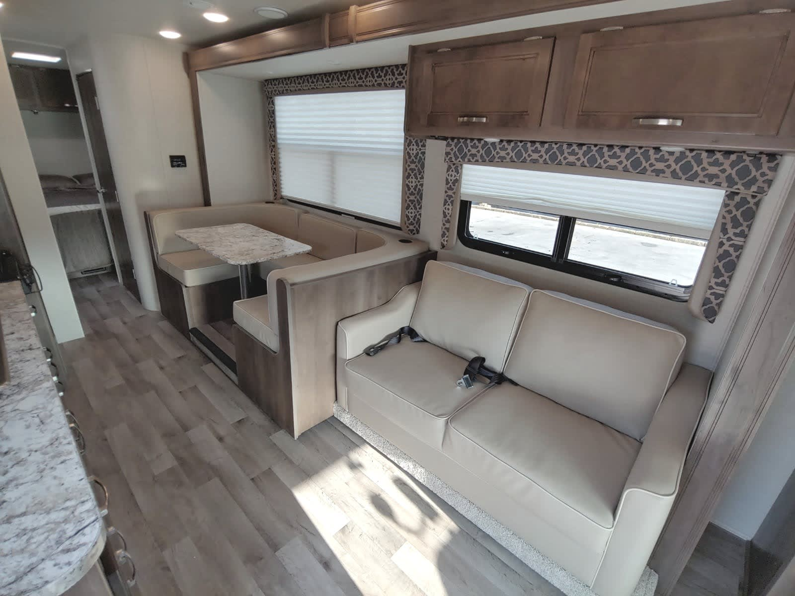 Interior of motor home, seating areas - slide-out not extended.. Jayco Redhawk 29XK 2019