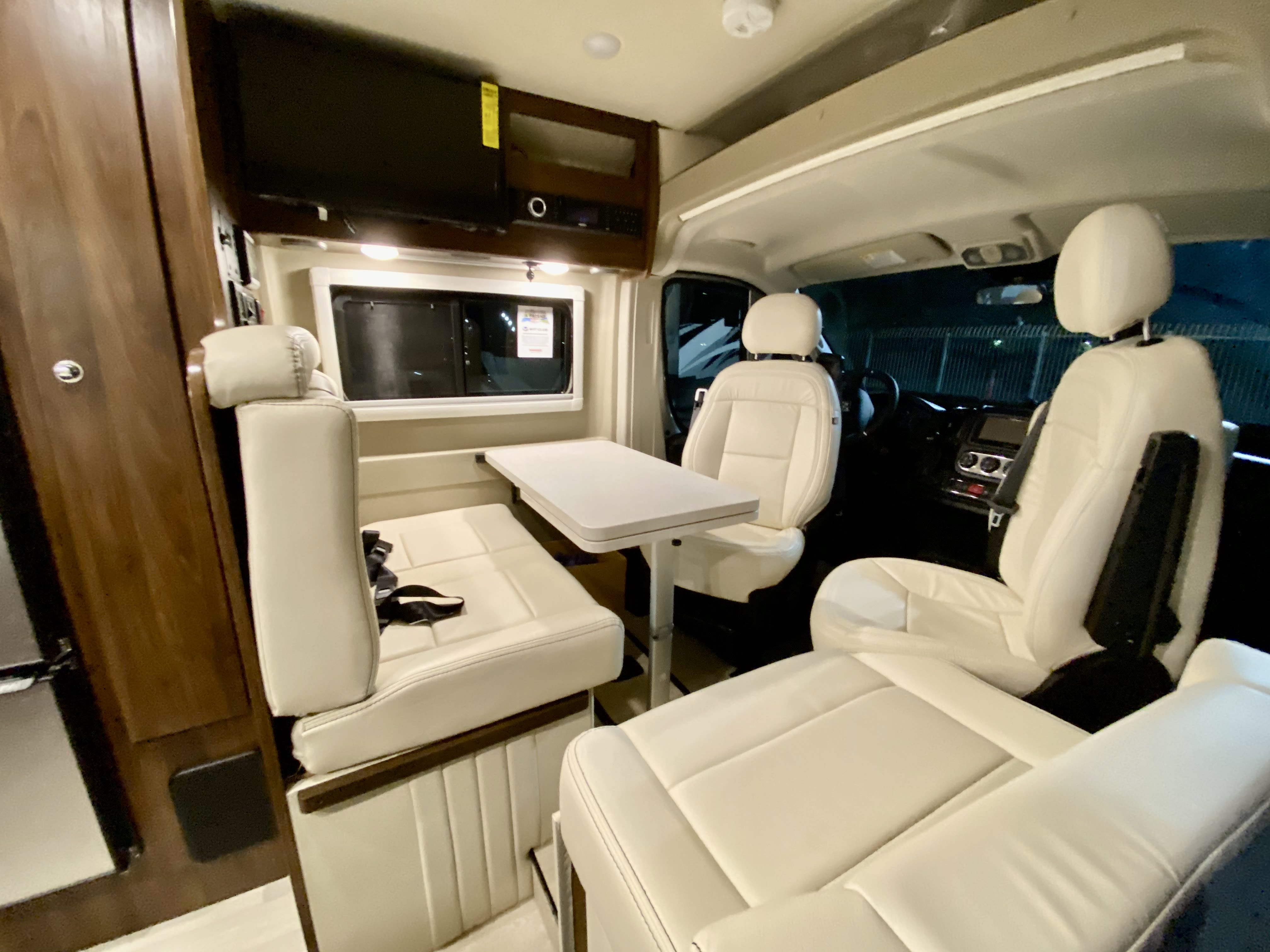 One of our favorite spots!  The driver and passenger seat swivel and voila! you have a nice eating area, a work area  and even great area for cards.. Winnebago Travato 2021