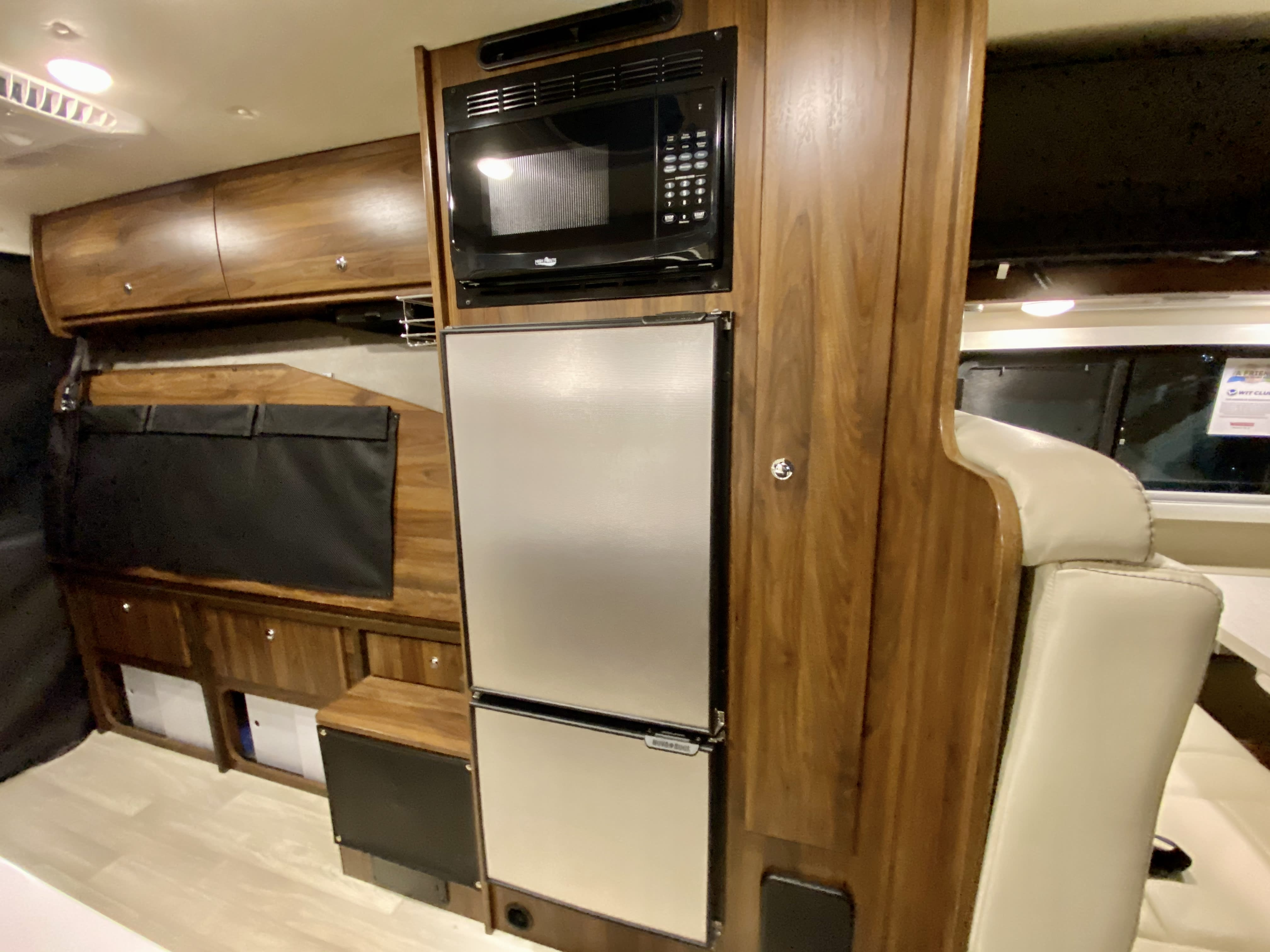 The rear portion of the rig contains a full size murphy bed which can be pulled up for maximum storage.   . Winnebago Travato 2021