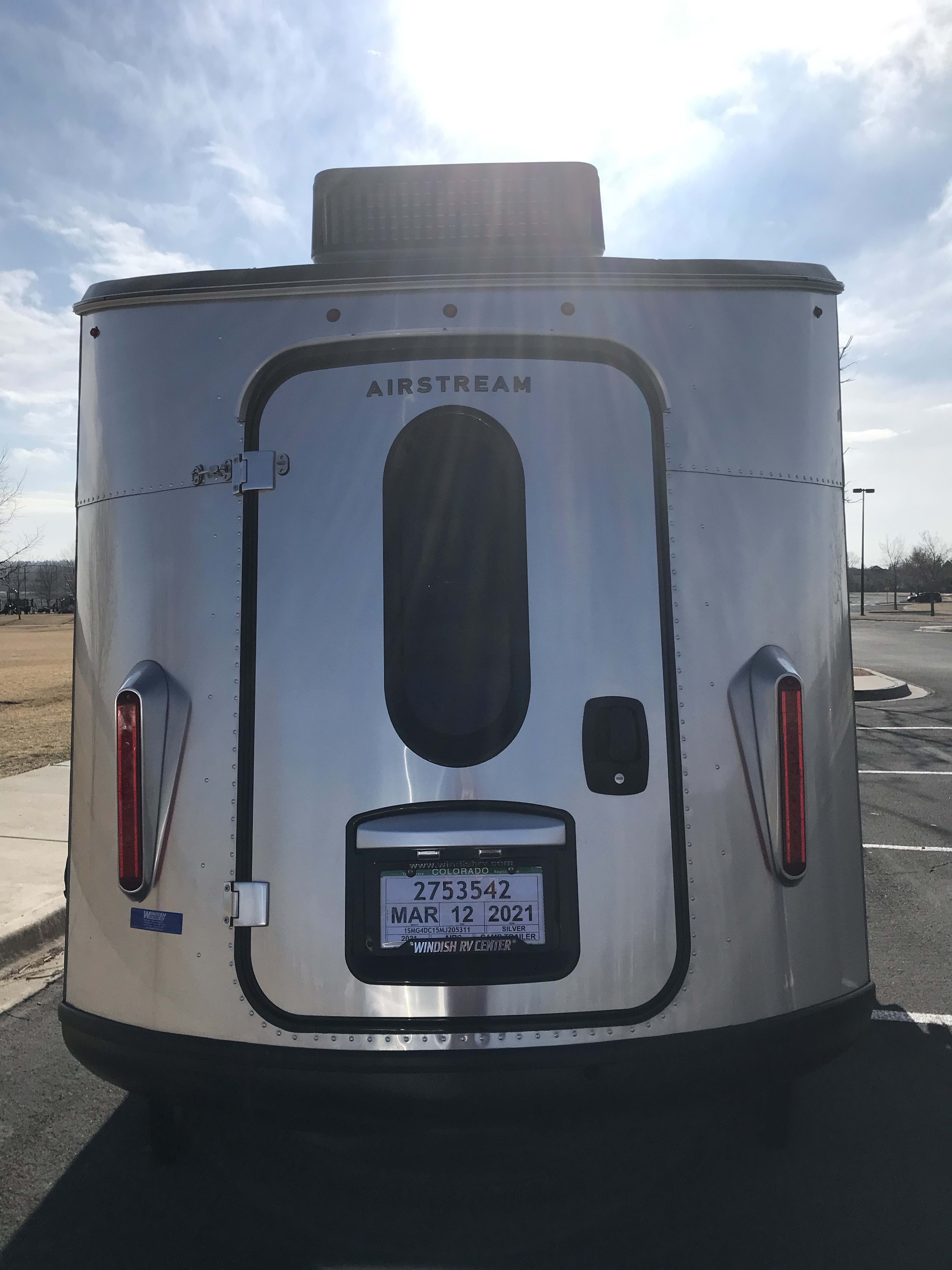 The back door is good for loading gear or allowing for a cross breeze. . Airstream Base Camp 2021