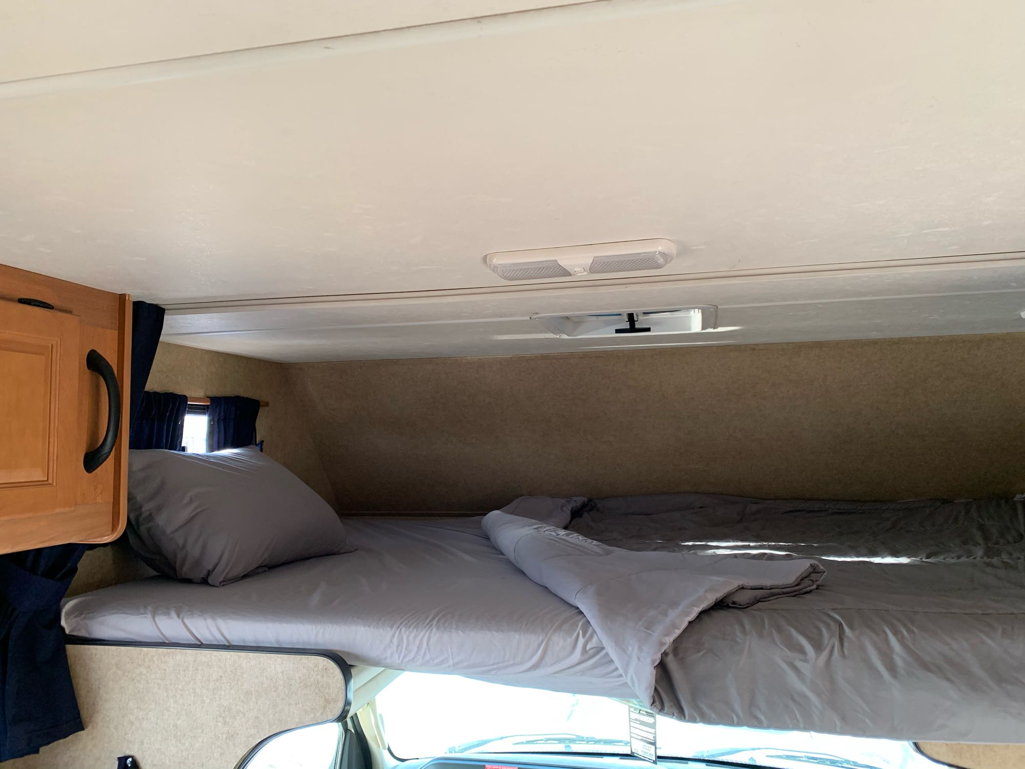 Overhead bed is great for kids, easily sleeps 2, linens provided if needed. Also great for extra storage space.. Thor Motor Coach Four Winds Majestic 2015