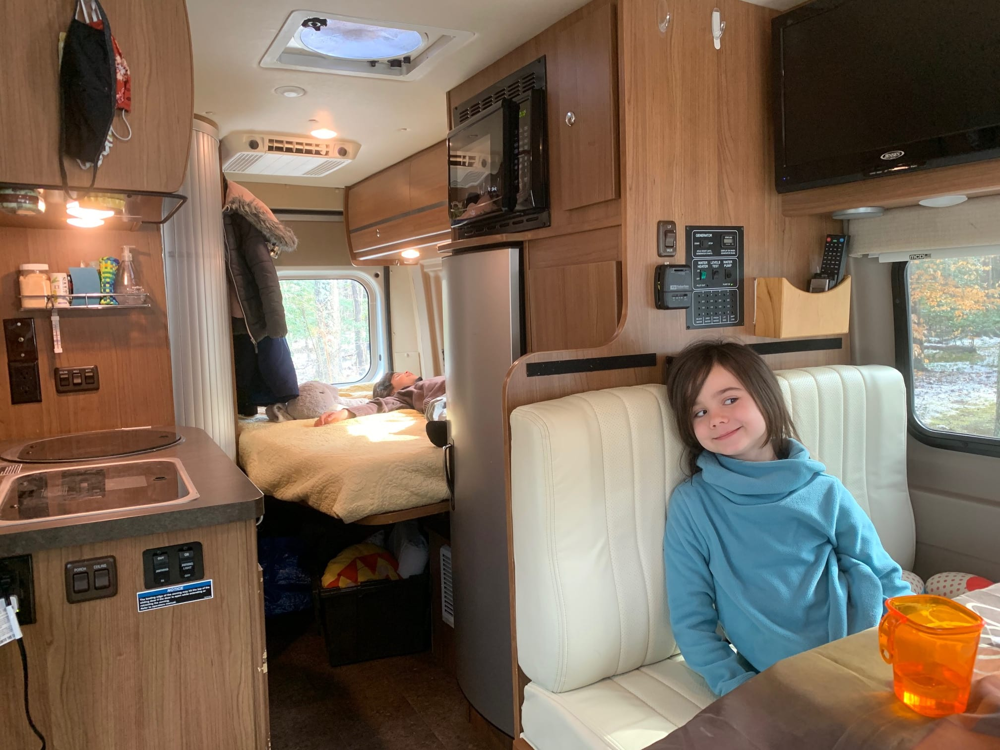 OMG the kids can be in two different locations in the same van! Note under loft bed storage in use in rear . Winnebago Travato 2015