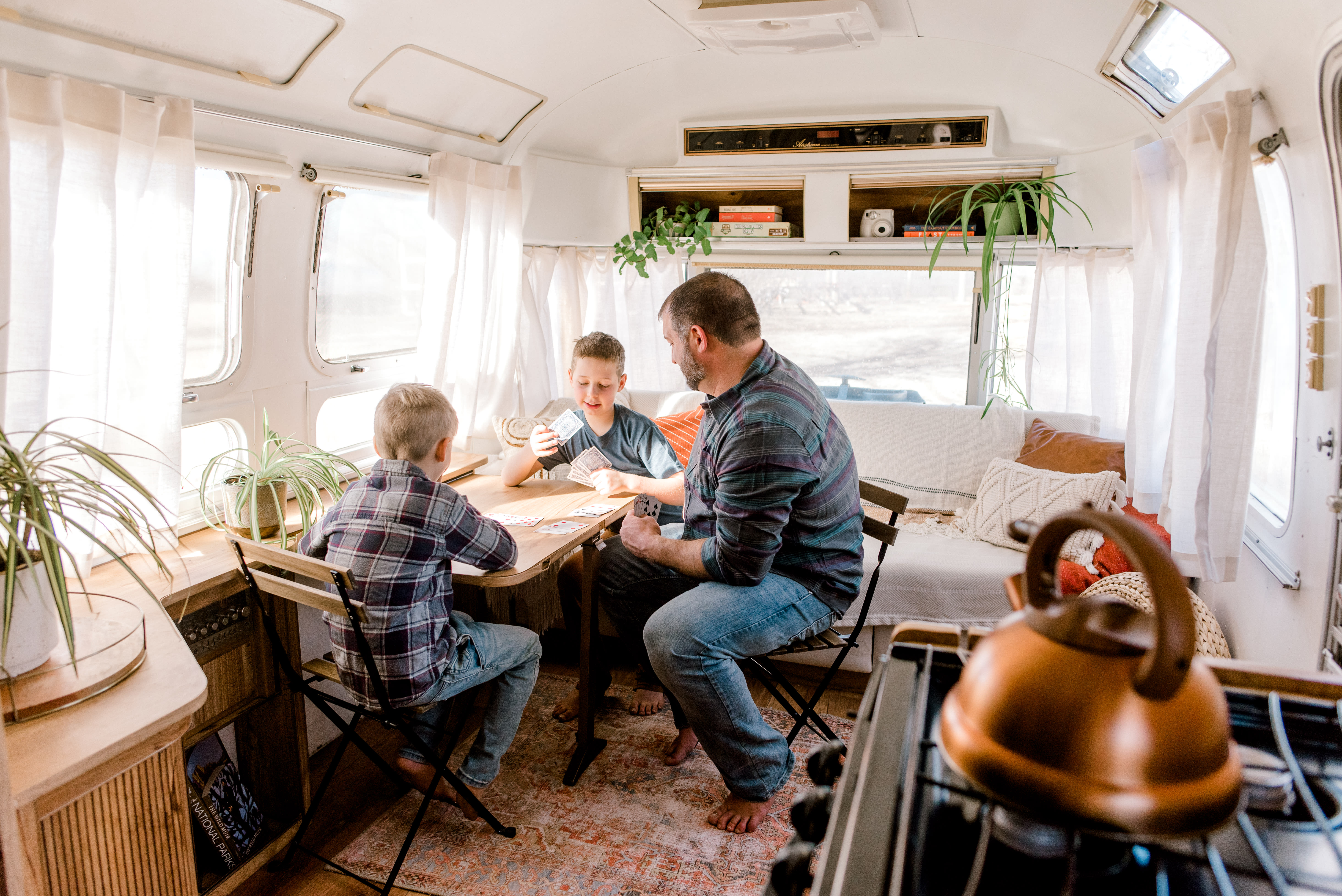 Carolina's interior is cozy, but roomy. We like to play cards at the table in the living room.. Airstream Excella 1983