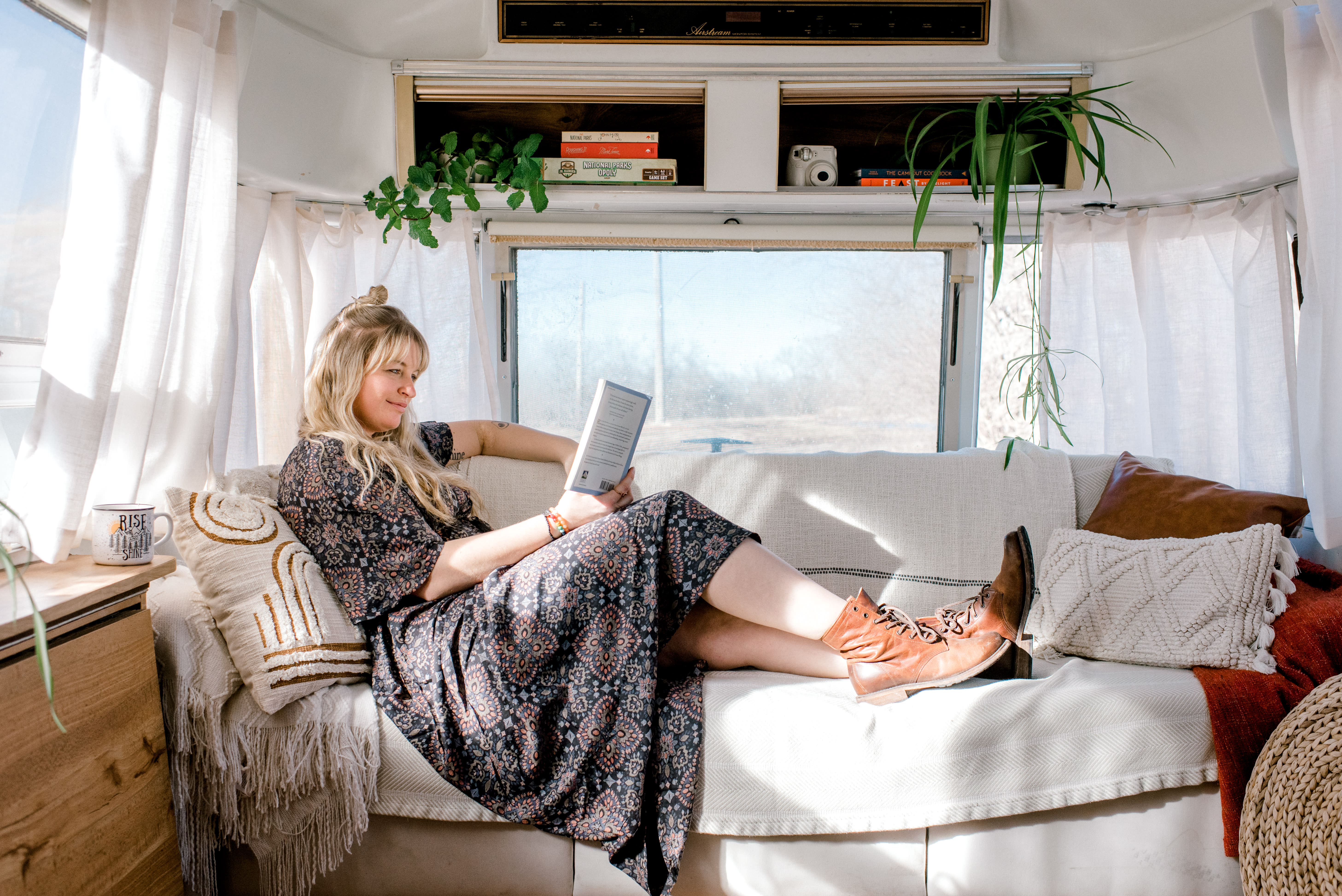 The couch is the perfect place to snuggle up with a good book.. Airstream Excella 1983